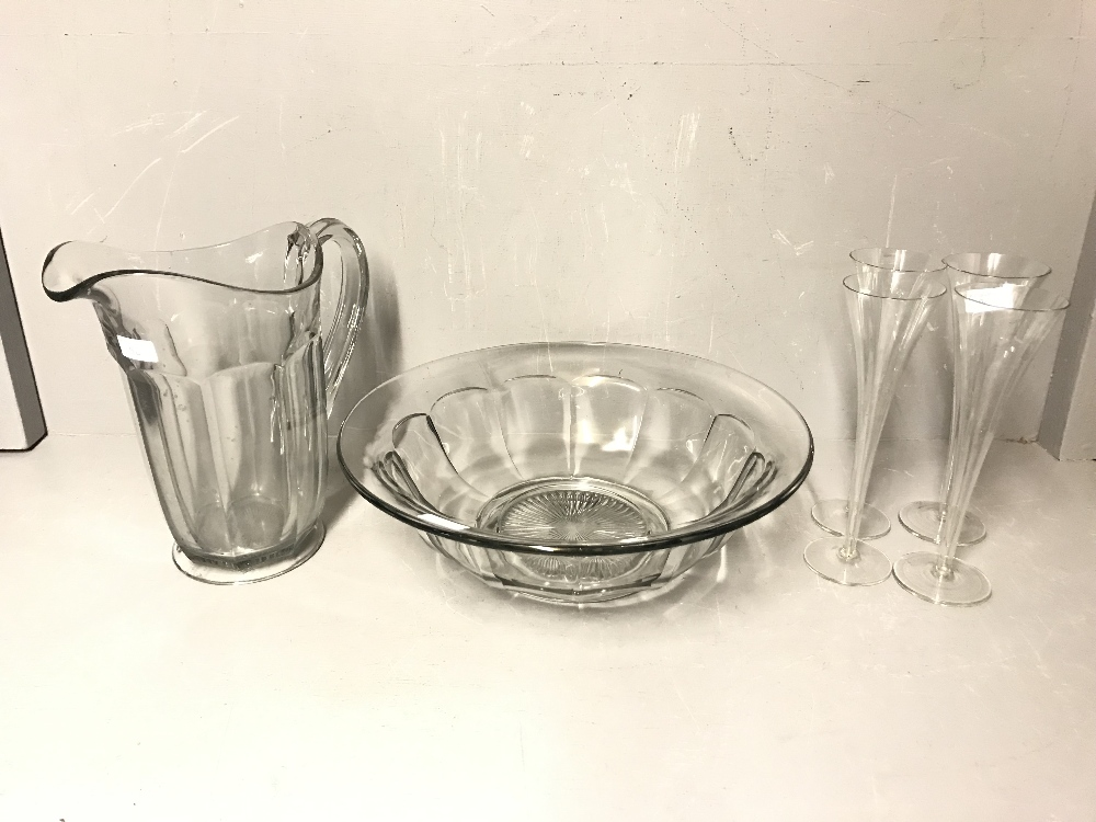 Lot 90 - Glass wash basin & glass ewer 39.5 cm, & 4 hollow stem champagne flutes 25 cm