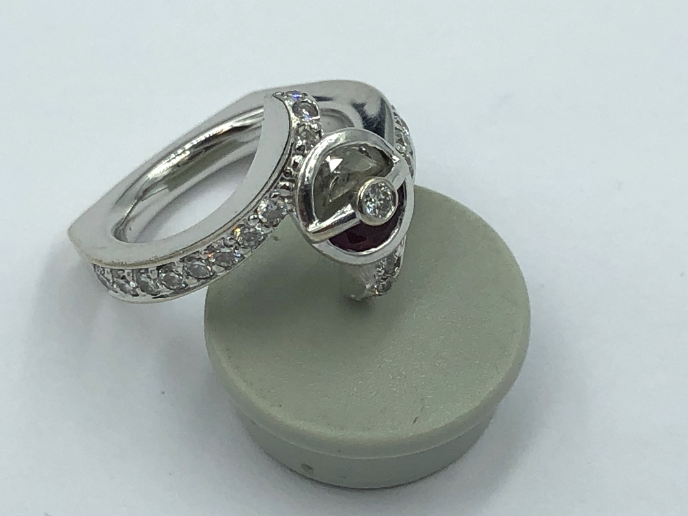 Lot 54 - 14ct White gold ring, central free cut ruby & diamond set with central diamond half set diamond