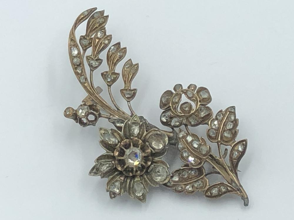 Lot 7 - NO ONLINE BIDDING LOTS 1-30.Gilt white metal diamond set flower spray brooch