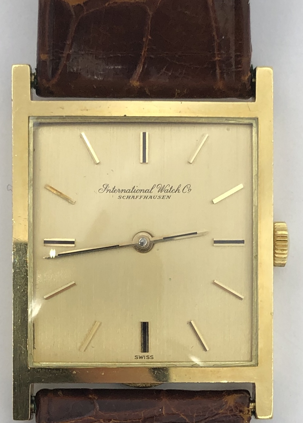 Lot 36 - 18ct gold IWC crown and rectangular faced wristwatch, gold face with gold baton markers