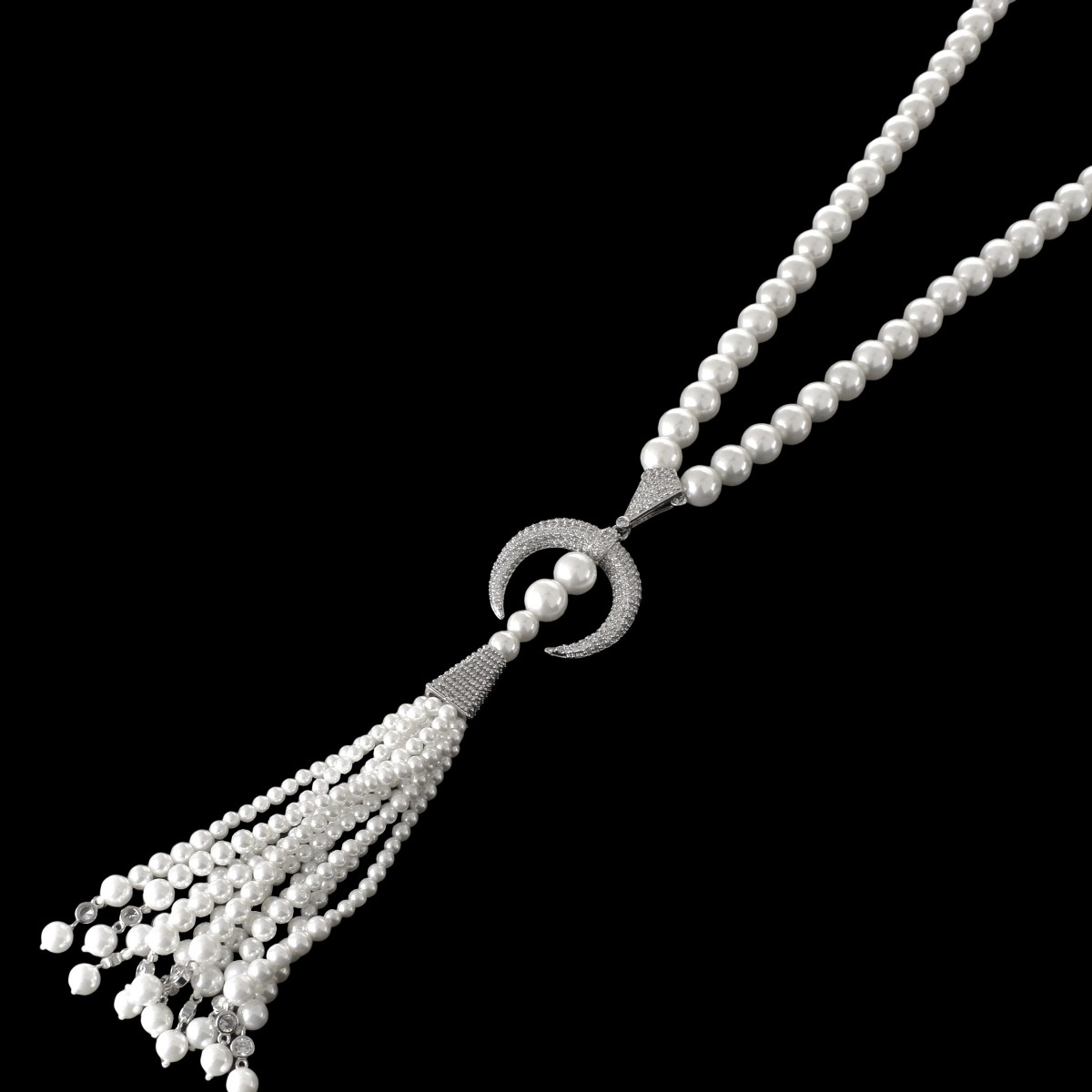 Lot 134 - Faux Pearl and CZ Tassel Necklace
