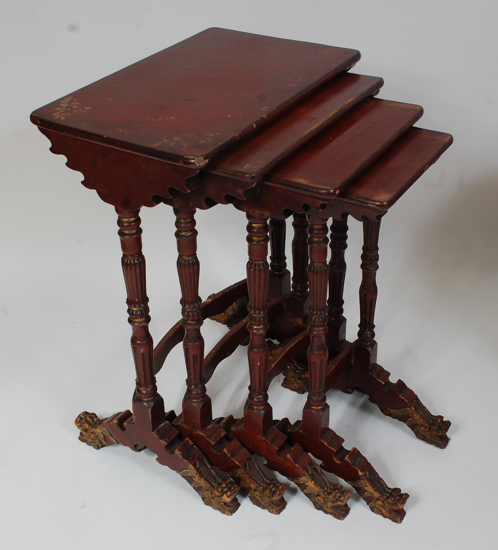 Lot 1325 - A Japanese Meiji period quartetto nest of occasional tables, each having rectangular red lacquered