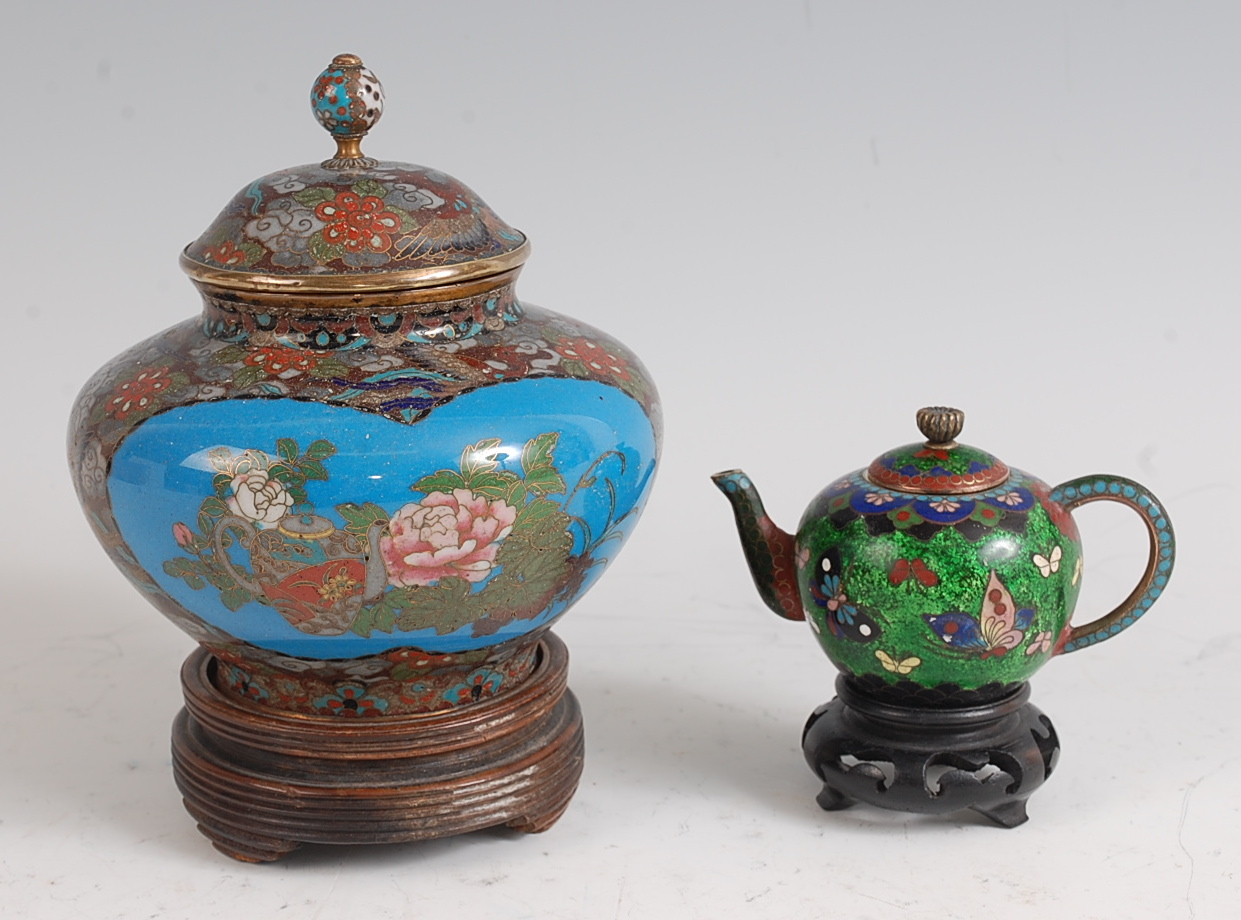 Lot 1316 - A Japanese Meiji period cloisonné enamel jar and cover, h.13cm, on turned hardwood stand; together