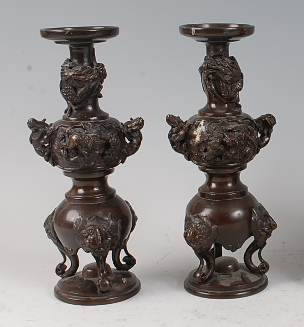 Lot 1317 - A pair of Japanese Meiji period double gourd bronze specimen vases , each with applied mythical