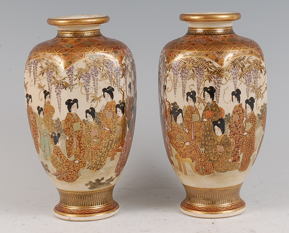 Lot 1320 - A pair of Japanese Meiji period Satsuma vases, each of hexagonal tapering form, decorated in the