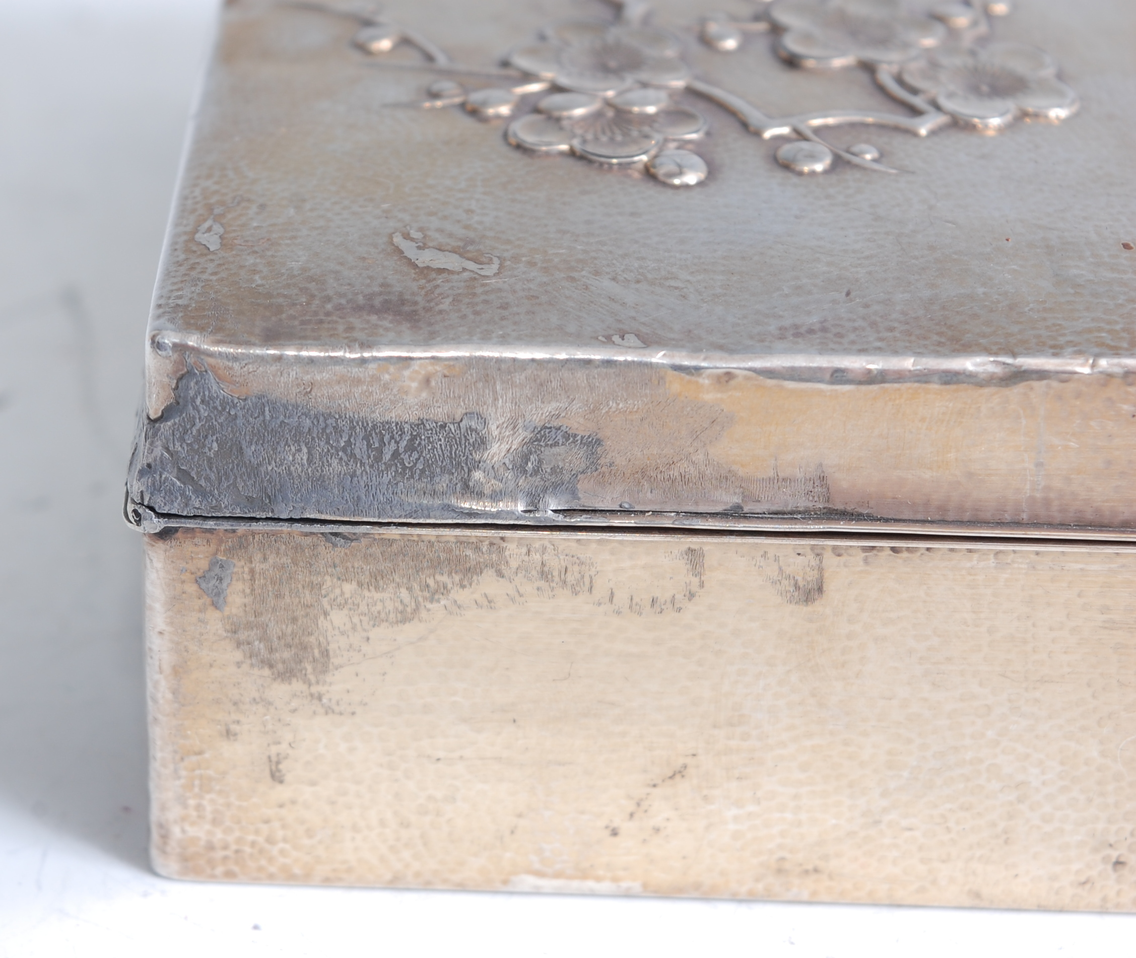Lot 1315 - A Japanese Meiji period white metal clad table cigarette box, of rectangular form, the hinged lid