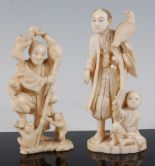 Lot 1321 - A Japanese Meiji period carved ivory okimono, of a robed figure with bird of prey and attendant