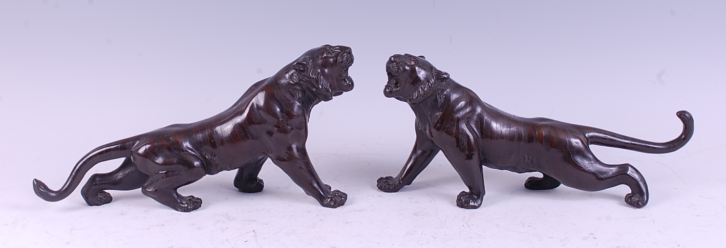 Lot 1319 - A pair of Japanese Meiji period bronze tigers, each naturalistically posed, each with seal marks