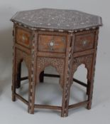 Lot 1326 - *A late 19th century Moorish occasional table, the octagonal top profusely decorated with bone