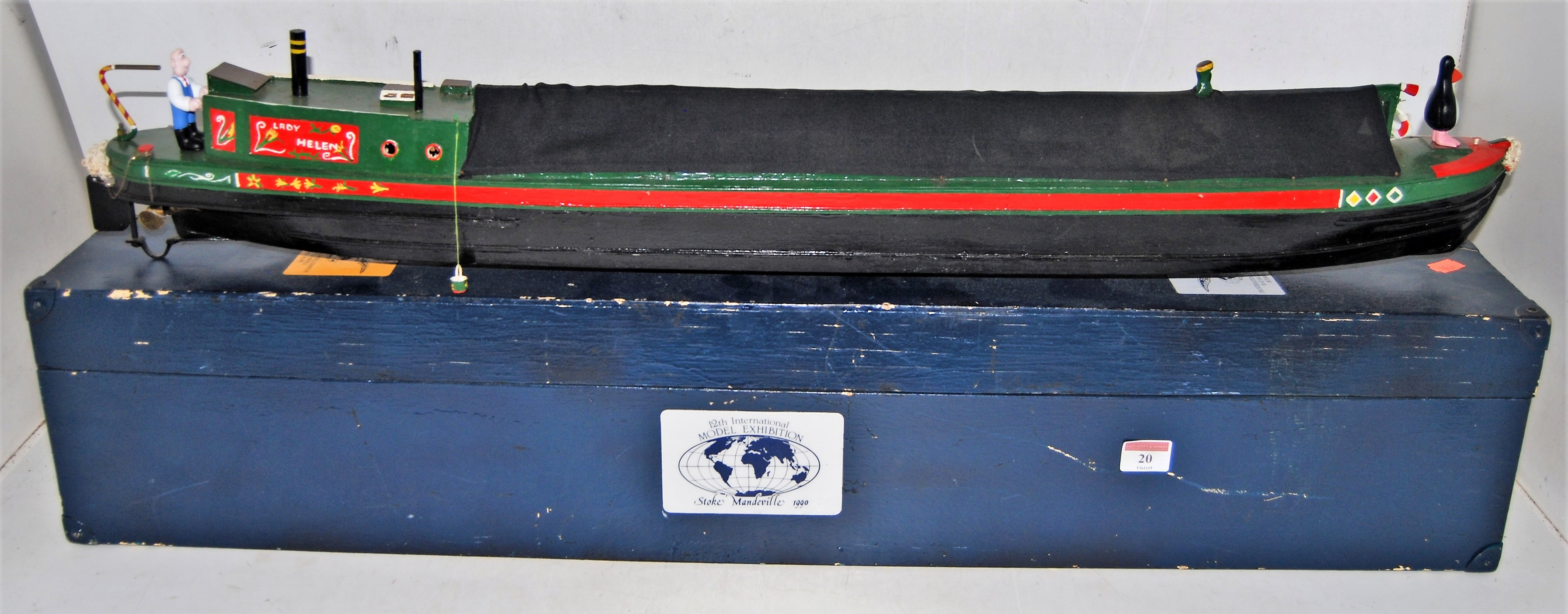 "Lot 20 - A wooden scratchbuilt model river longboat named ""Lady Helen"" finished in black, red and green, with"