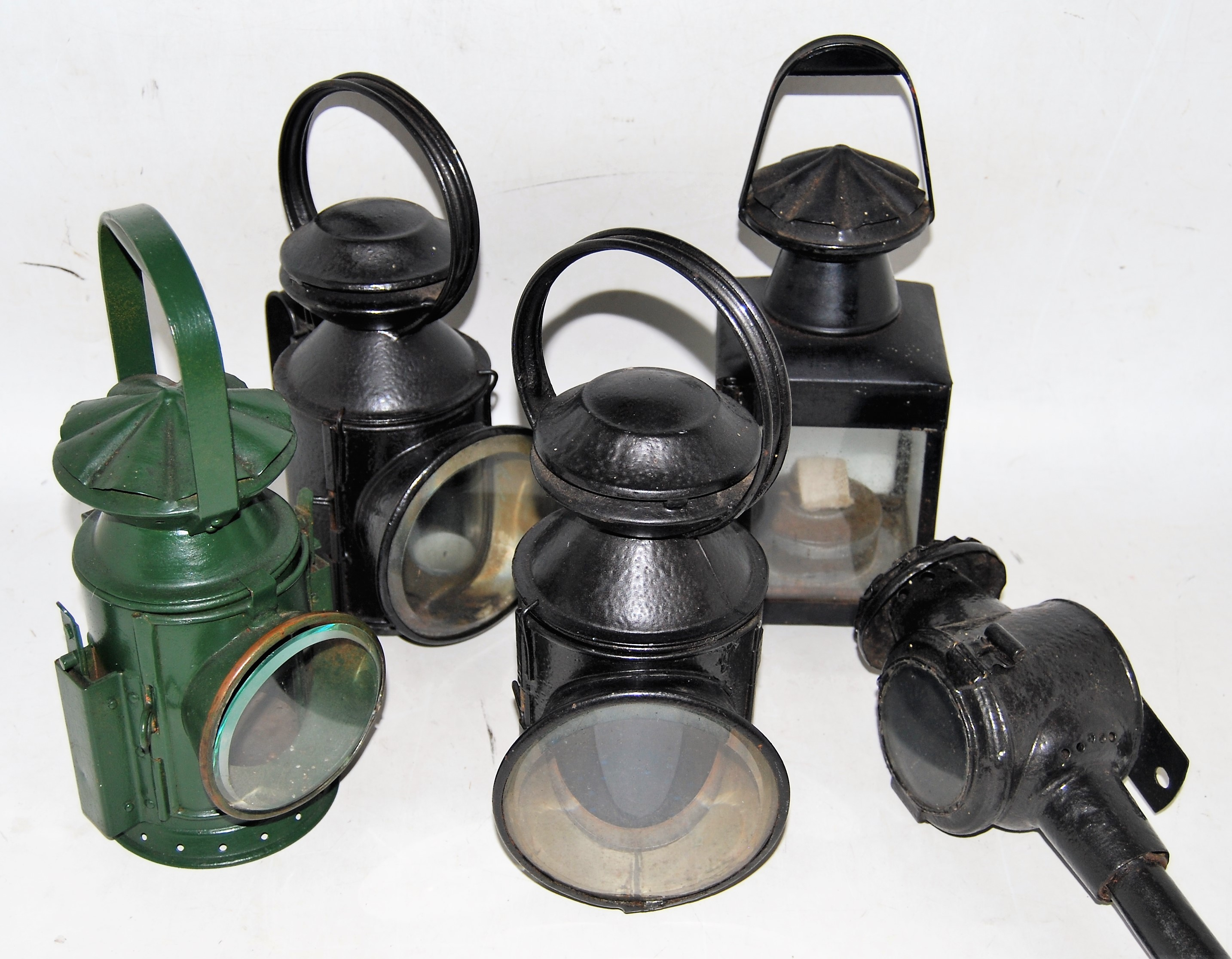Lot 25 - Three railway hand lamps, all complete with lenses and aspect glasses but not reservoirs etc, a BR
