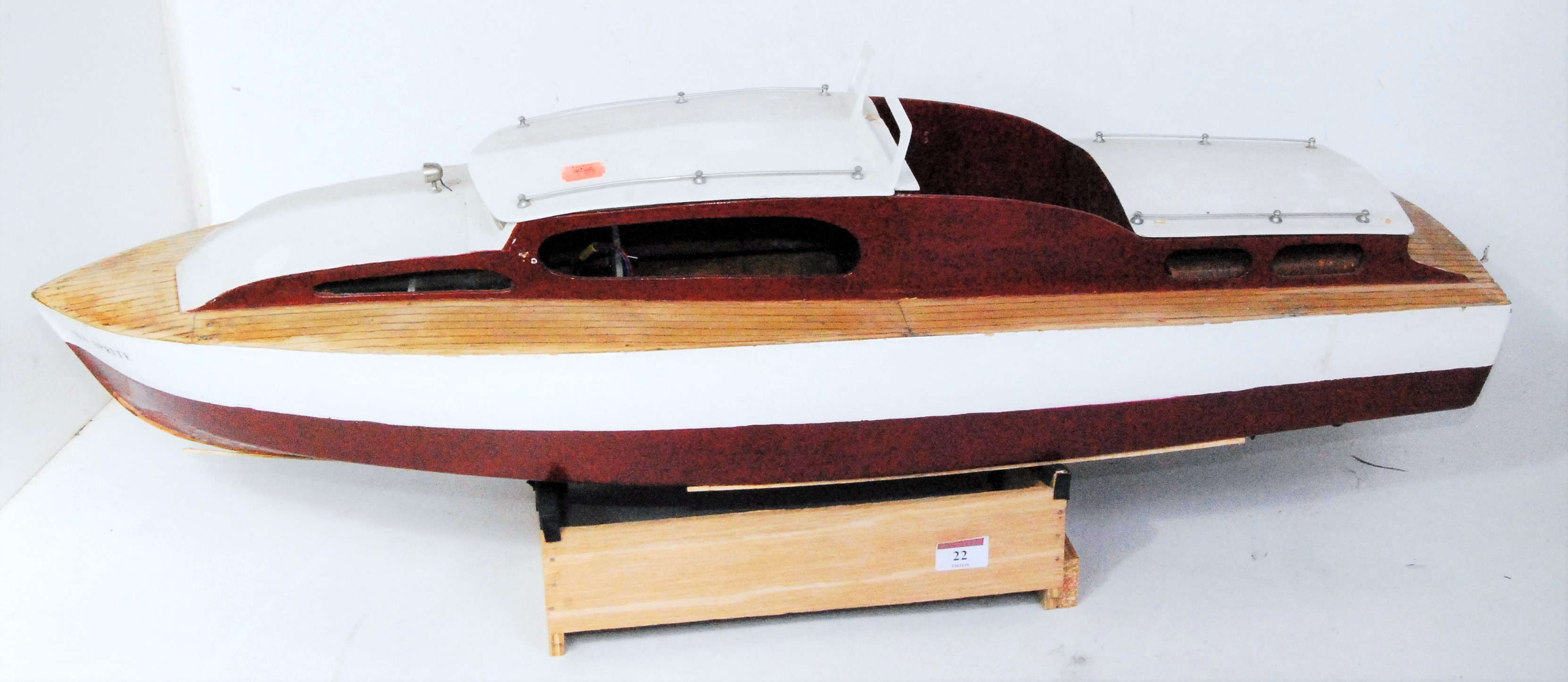 Lot 22 - A kit built wooden and balsa wood model of a radio controlled cabin cruiser finished in maroon and