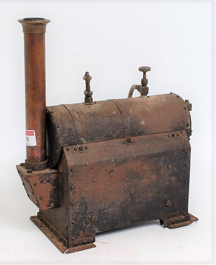 Lot 35 - An early 20th century model of a tin housed and copper stationary steam boiler, comprising of copper