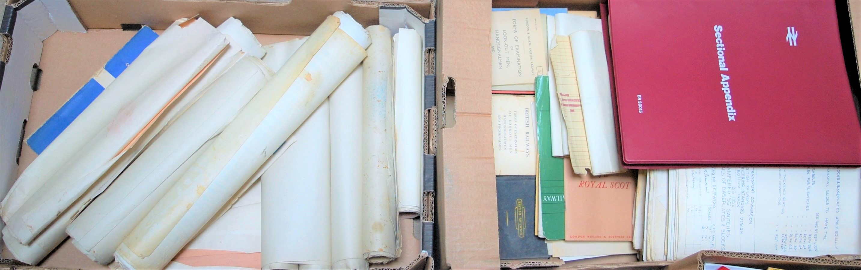 Lot 26 - Two trays containing civil engineers reference material track diagrams, working time tables, soft