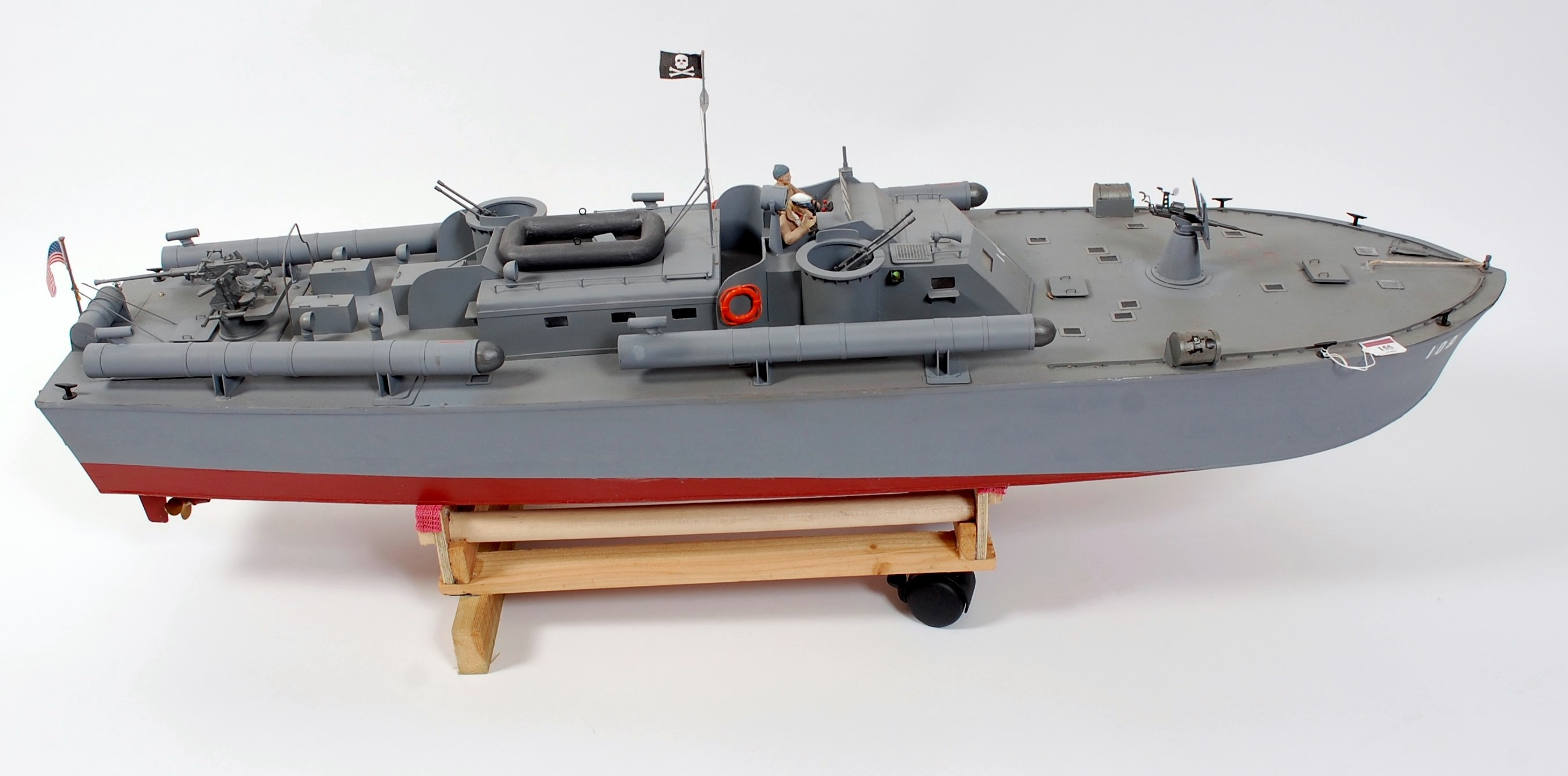 Lot 57 - A scratch built balsa wood model of a PT109 Torpedo boat, comprising grey and red hull and