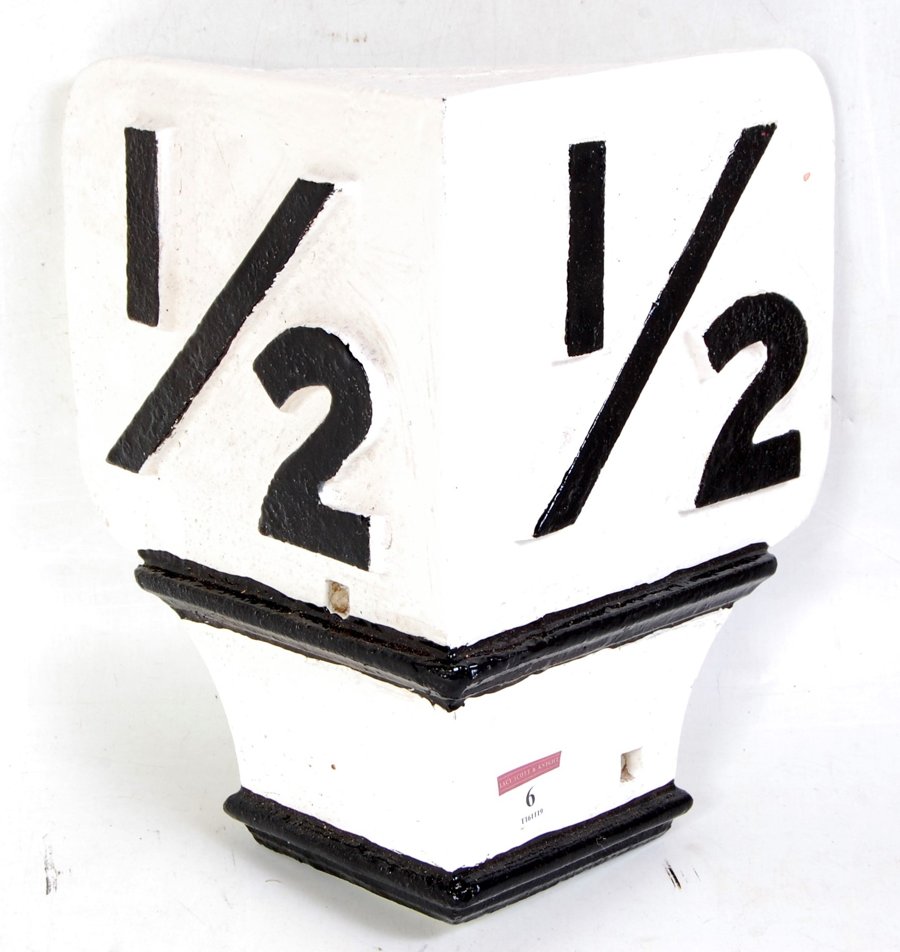 Lot 6 - An original cast iron railway half mile signpost top overpainted black on white