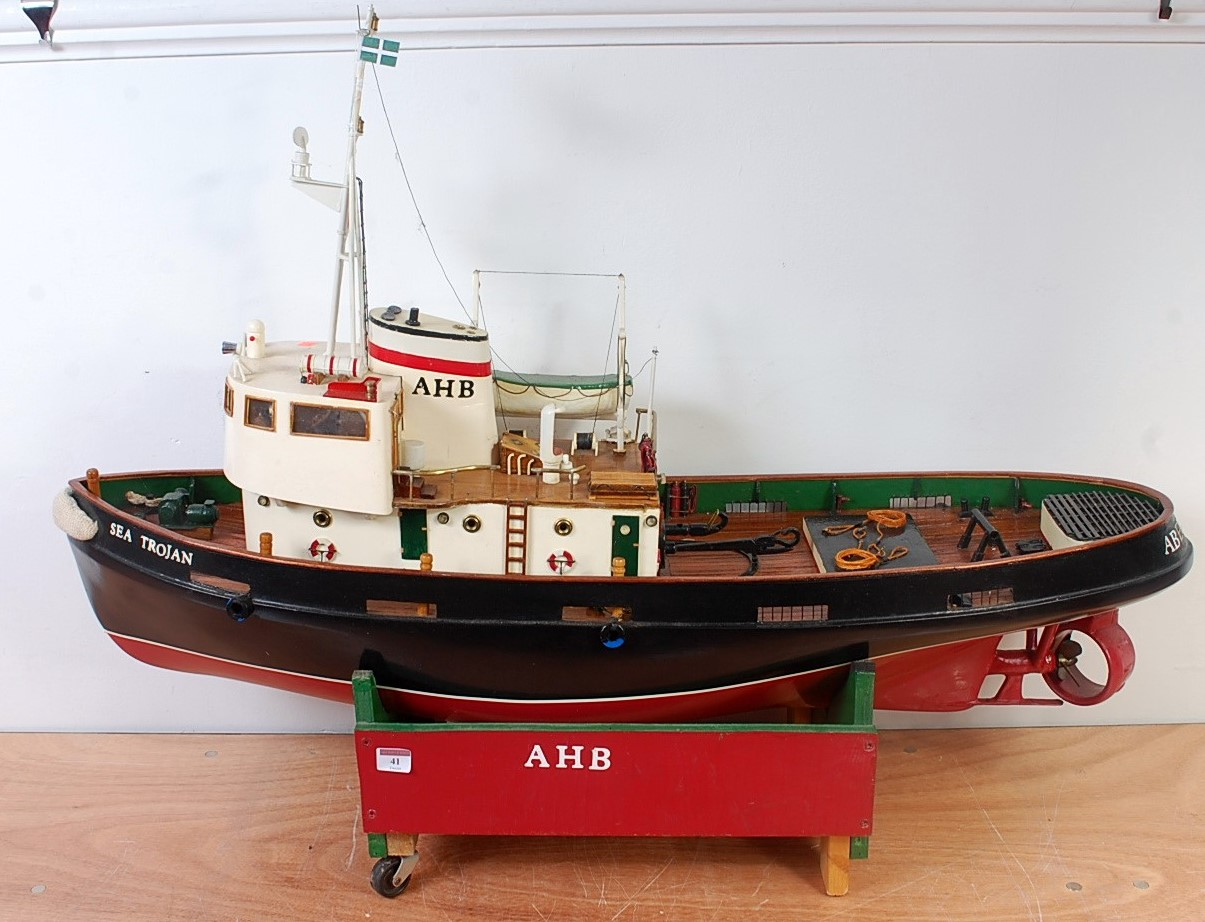 Lot 41 - A very well made wooden and vac form hulled model of a Sea Trojan tug boat, suitable for use for
