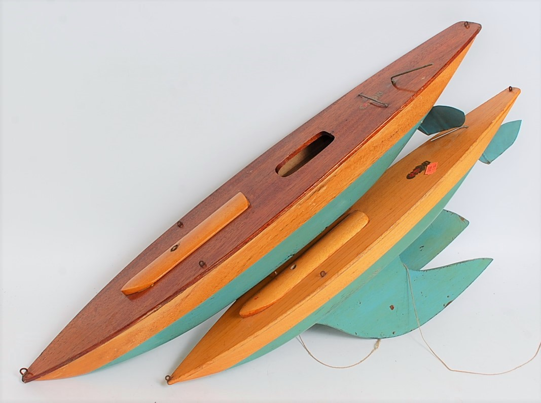 Lot 23 - Two Bowman Models of Dereham wooden pond yacht hulls comprising of stained wooden desk with lower