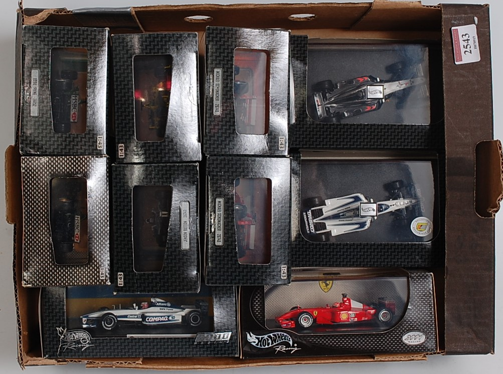 Lot 2543 - Ten various boxed Hotwheels Racing No. 2000 Racing Series F1 diecasts to include a Michael