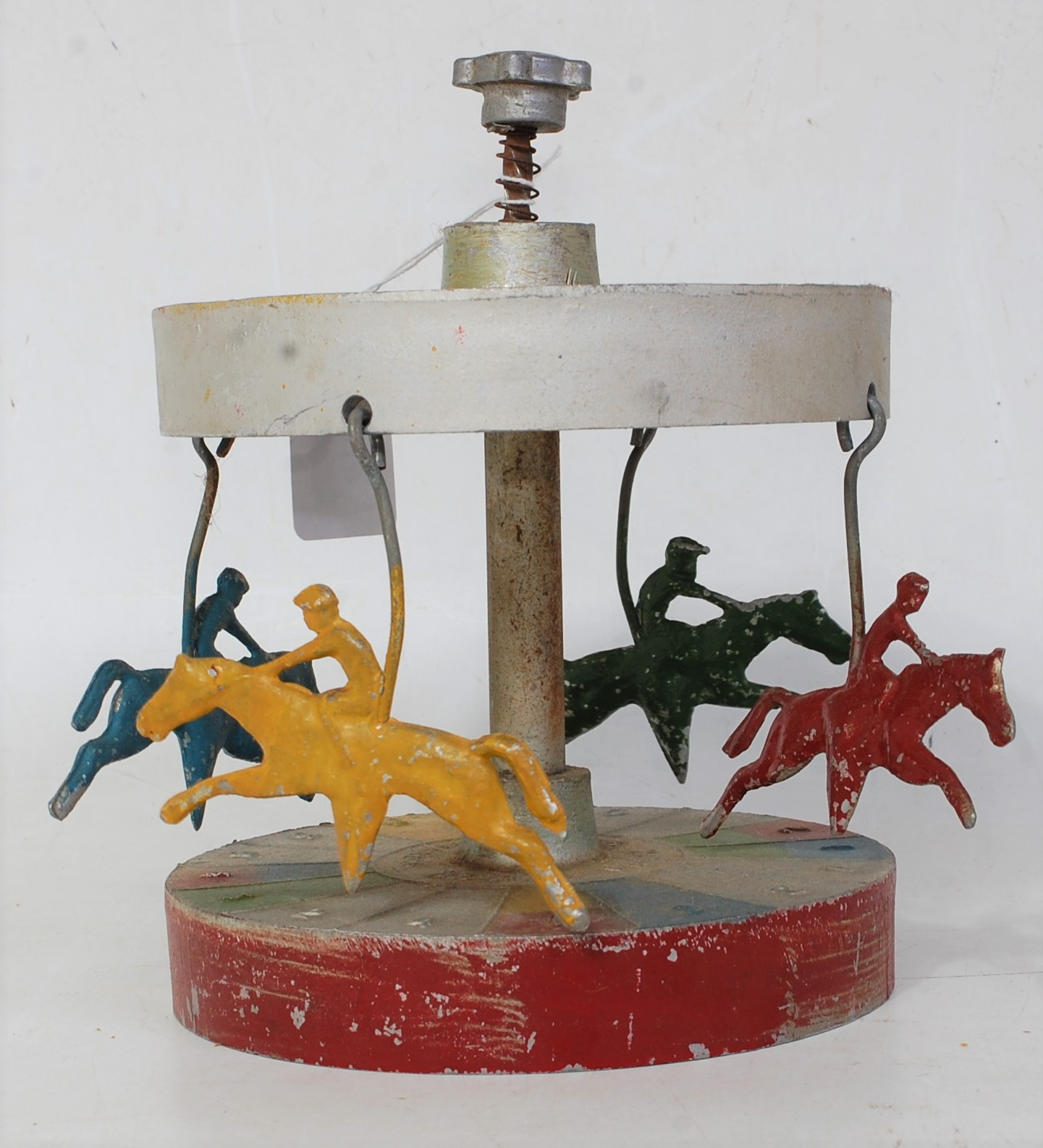 Lot 3219 - A 1940s Spira Chase racing game, cast alloy mechanical carousel, hand operated example with plunge