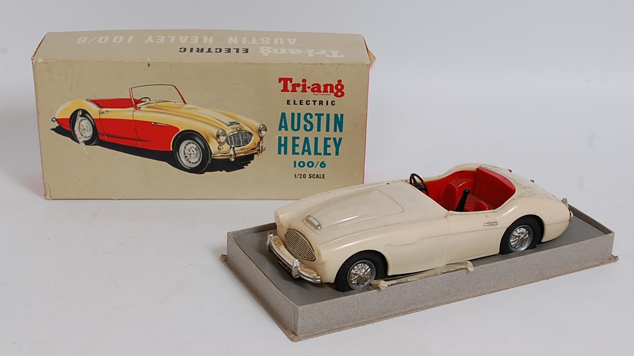 Lot 3180 - A Triang No. 100/6 1/20 scale model of an Austin Healey comprising of cream body with red interior
