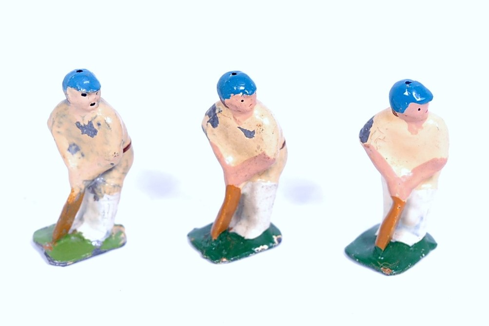 Lot 1304 - An F Kew & Co collection of three various lead hollow cast cricket batsmen, all wearing whites