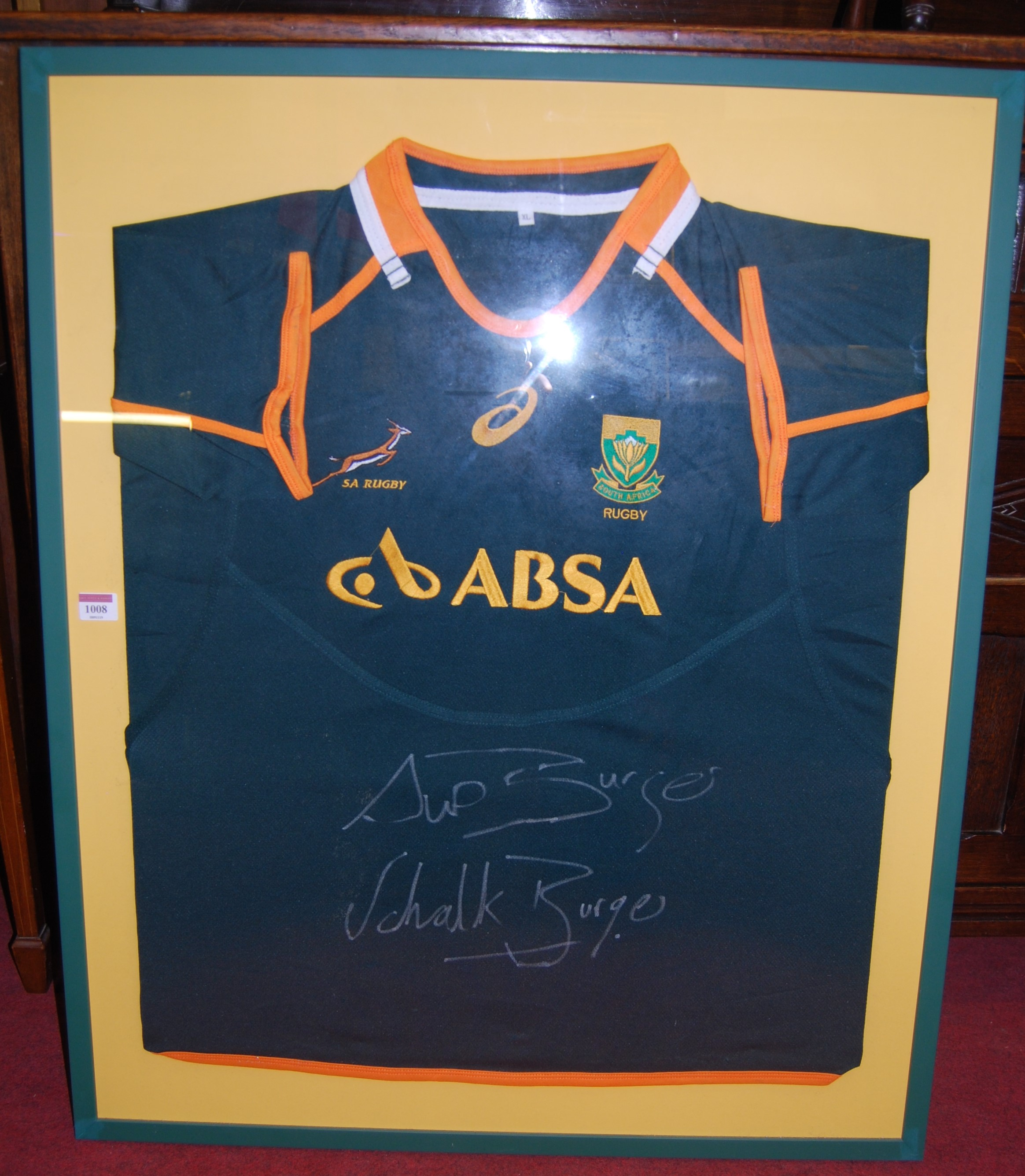 Lot 1008 - A framed South African rugby shirt, signed by Schalk Burger and Sup(?) Burger