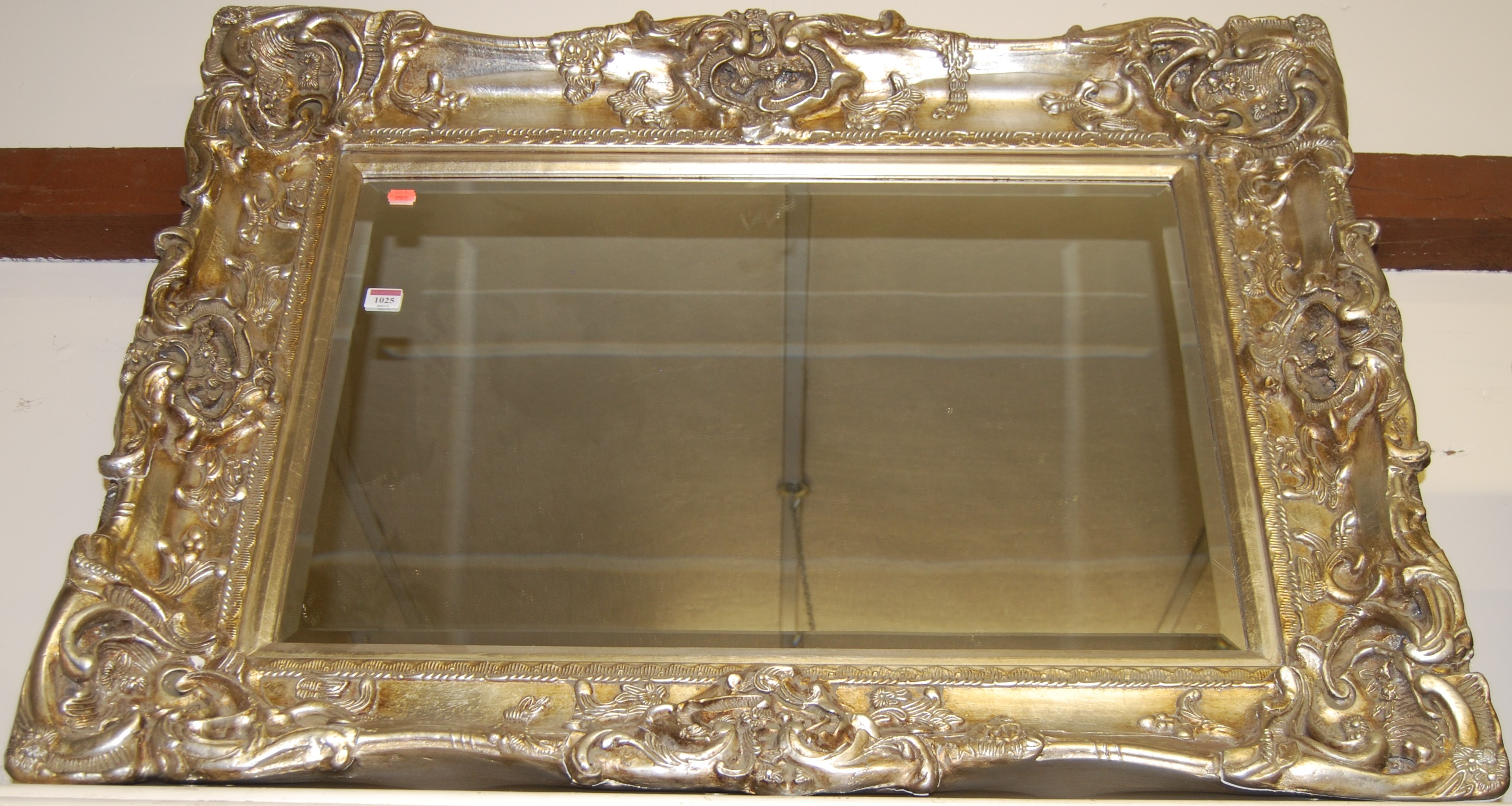 Lot 1025 - A reproduction silvered composition moulded wall mirror, 81 x 106cm