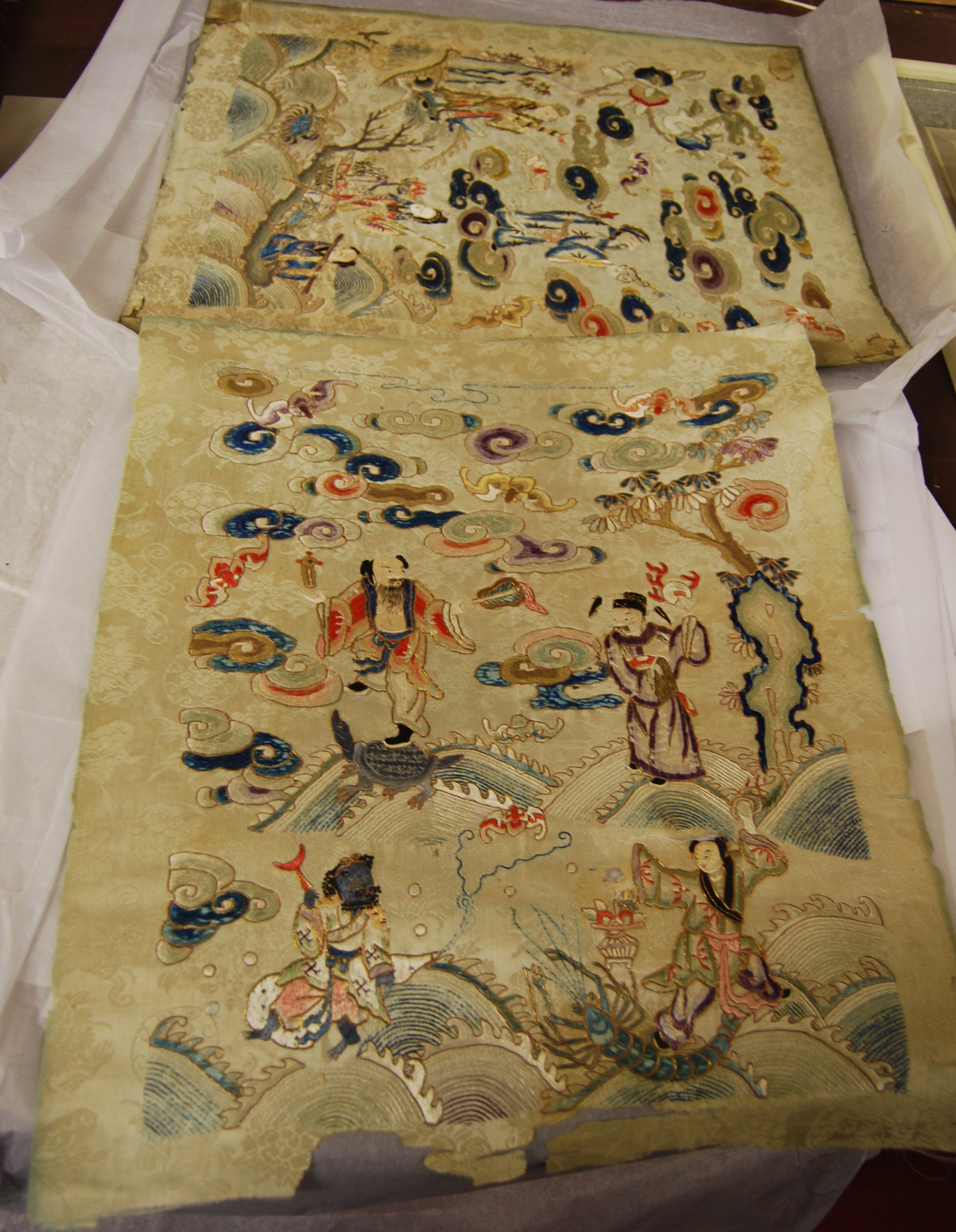 Lot 1054 - A pair of 19th century Oriental woven silk panels, each approx 38 x 45cm; together with a
