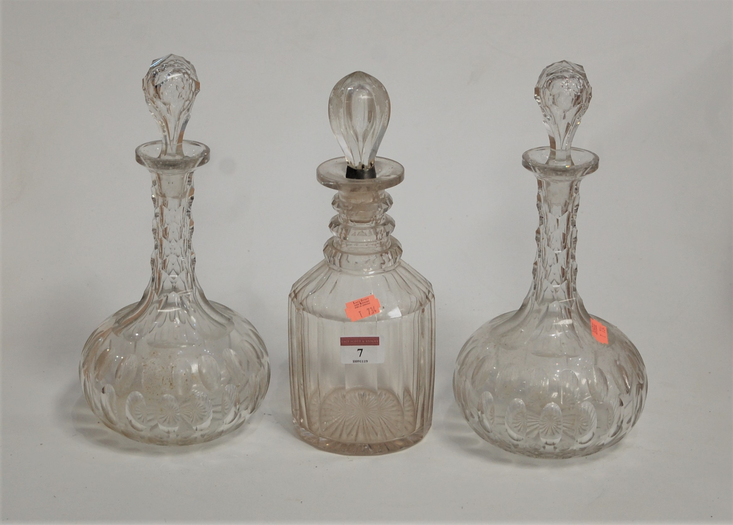 Lot 7 - A Regency cut glass triple neck decanter, having star cut base and balloon shaped stopper;