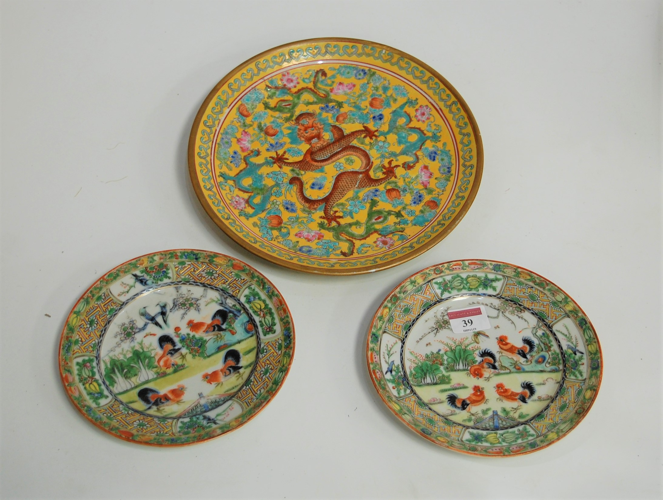 Lot 39 - A modern Chinese plate, on a yellow ground with enamel floral decoration, with central five claw