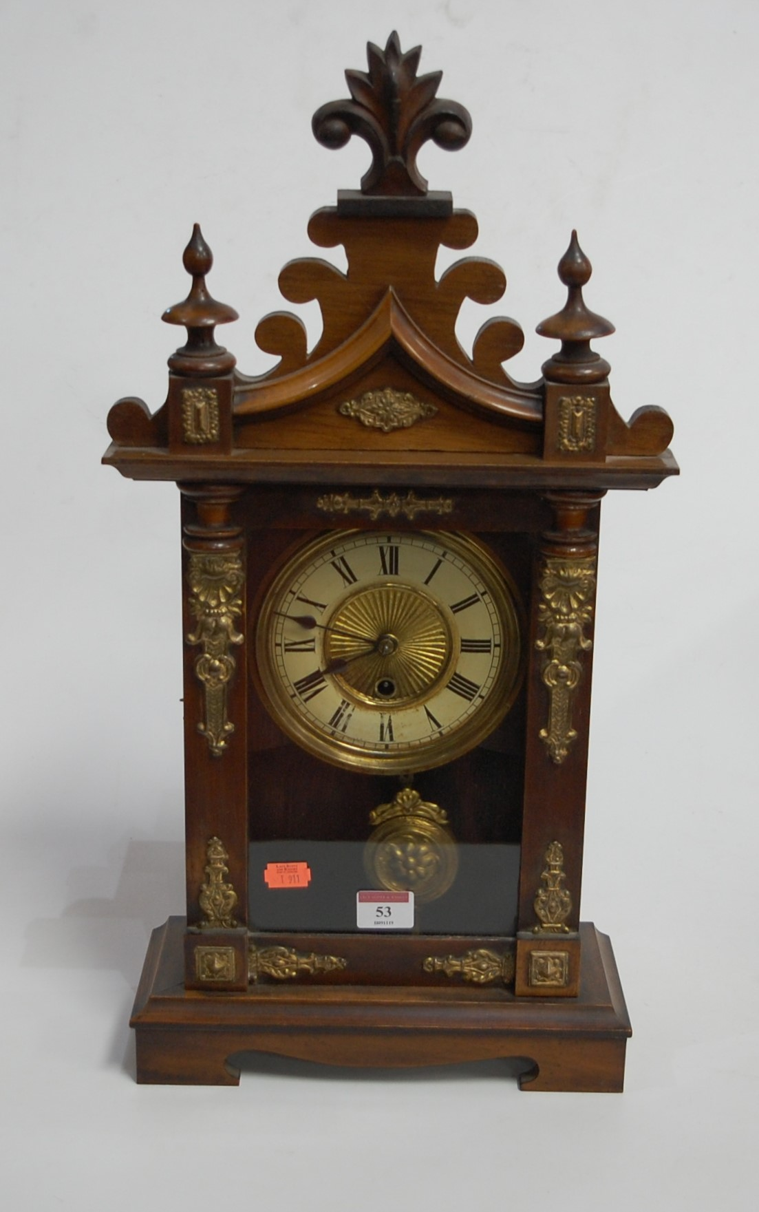 Lot 53 - A late 19th century continental walnut cased mantel clock, having enamelled chapter ring, with Roman