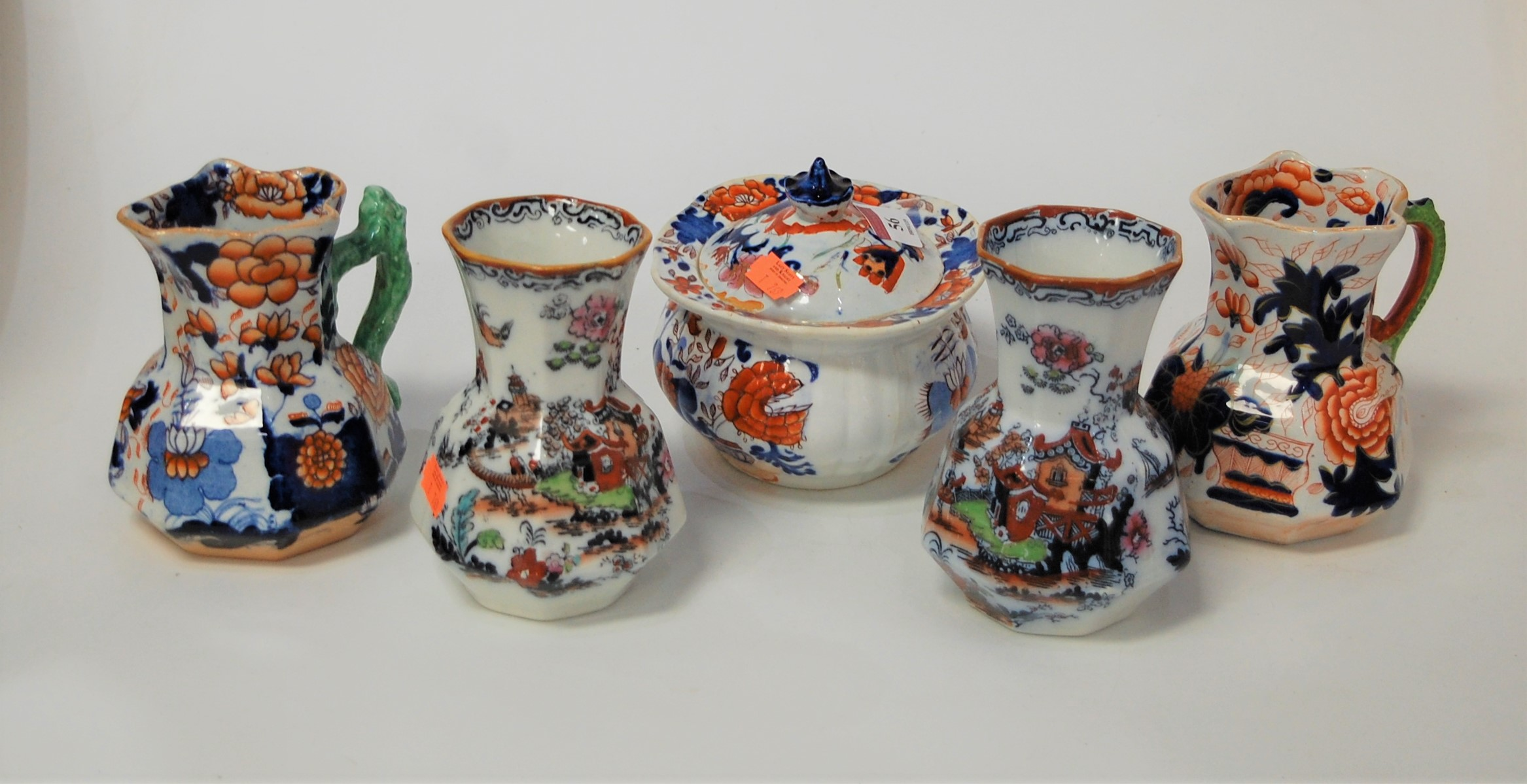 Lot 56 - Two Victorian Mason's ironstone hydra jugs; together with a pair of Mason's ironstone vases; and a