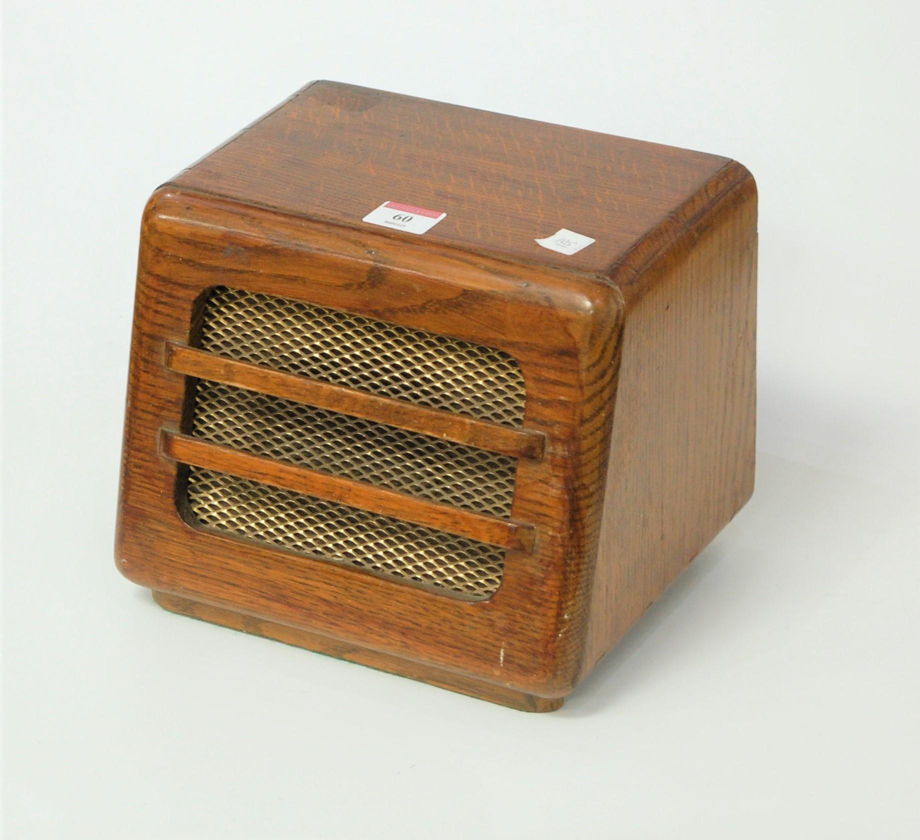 Lot 60 - A 1950s oak cased speaker with brass grille, w.24cm
