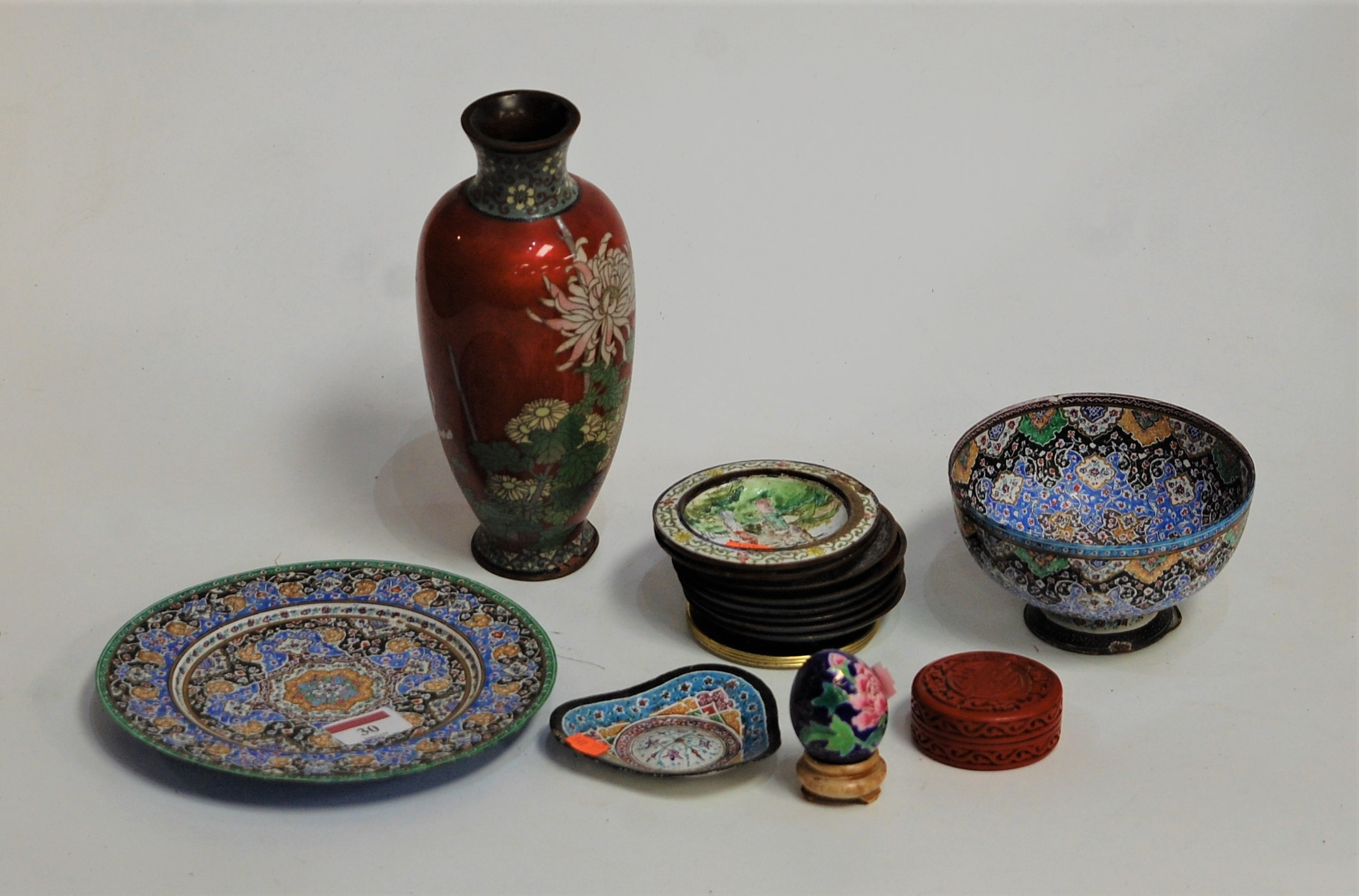Lot 30 - An early 20th century Japanese cloisonné vase, of baluster form, on a red ground decorated with