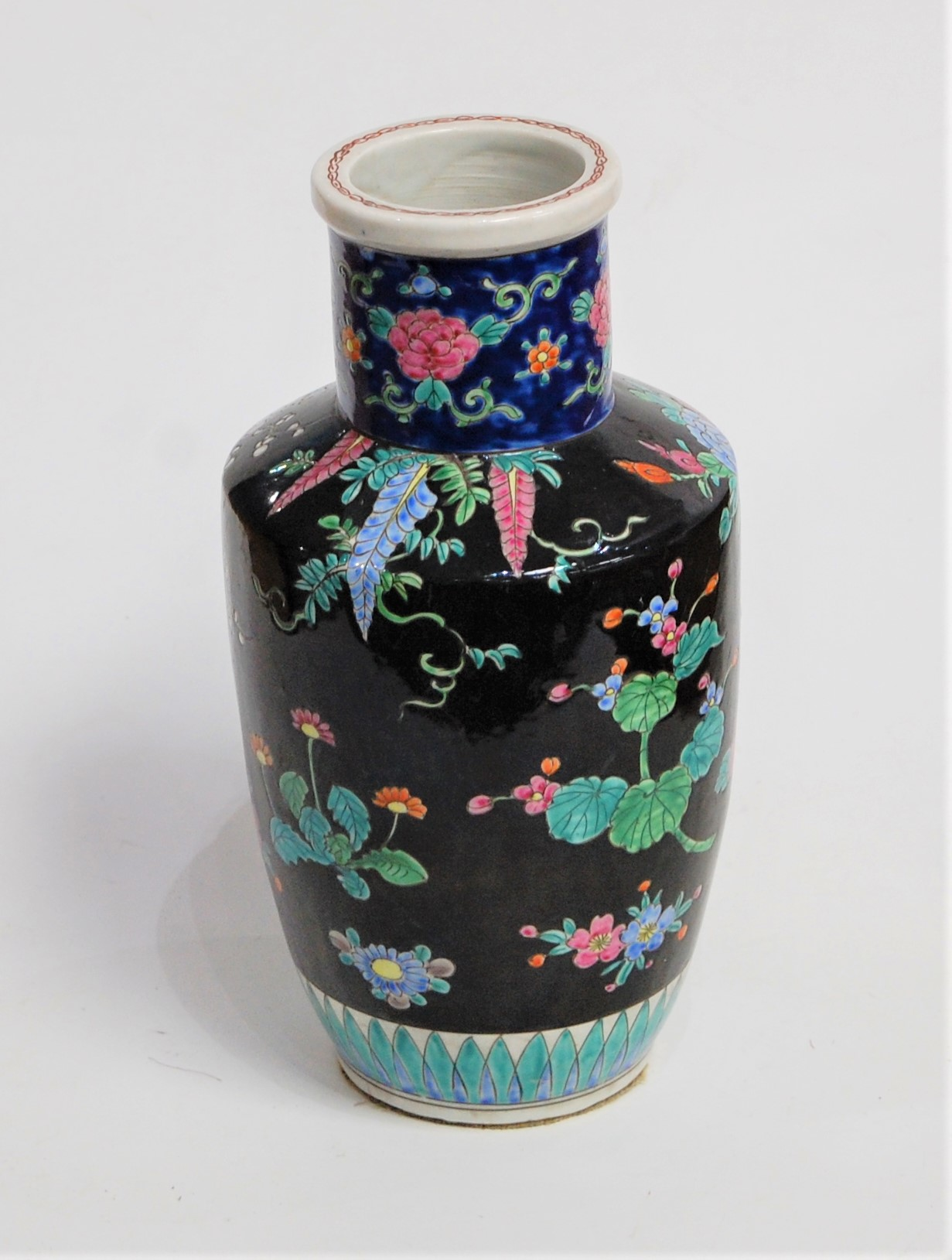 Lot 29 - A Chinese stoneware vase, of baluster form, on a black ground enamel decorated with flowers, h.31cm