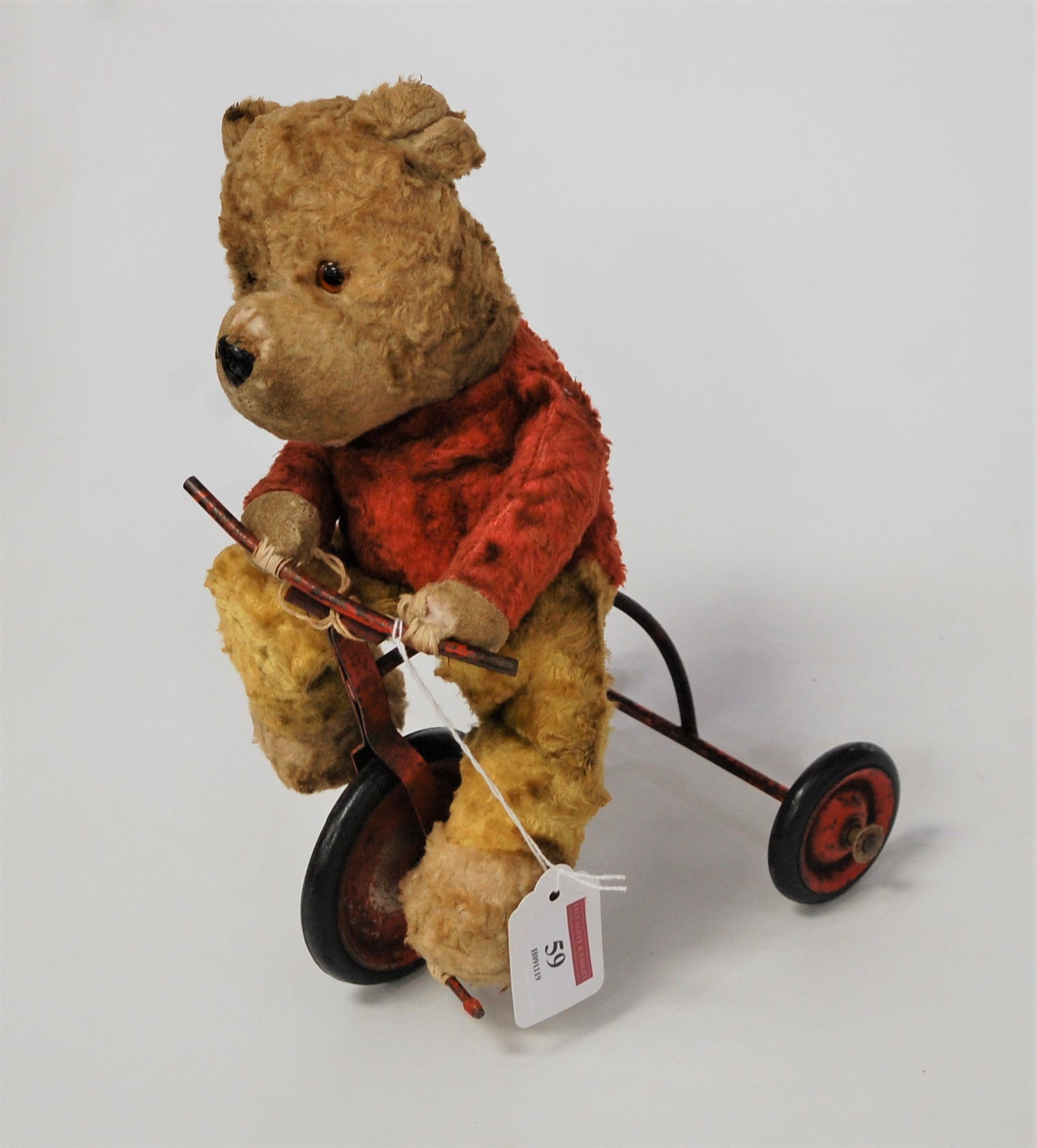 Lot 59 - A 1950s Chiltern Products child's push-along bear on tricycle, h.27cm
