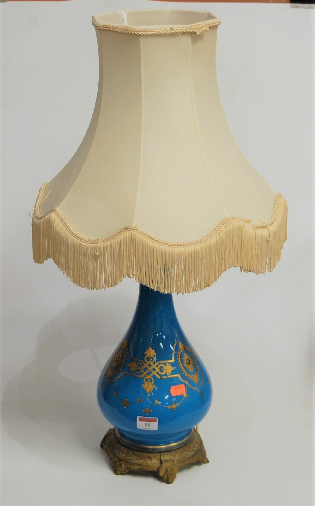Lot 10 - A French style blue glazed and gilt metal mounted table lamp, having applied gilt and enamel