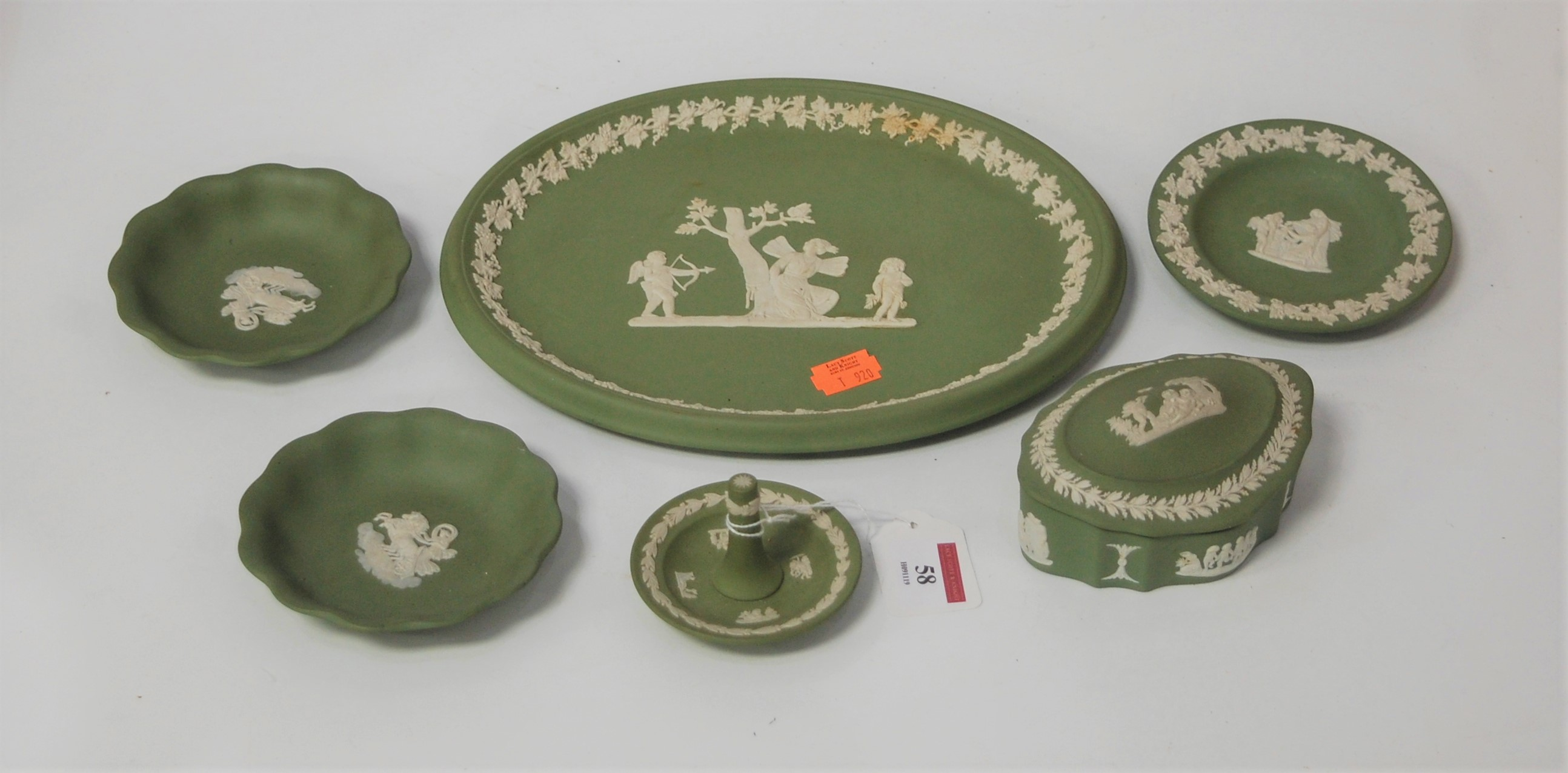 Lot 58 - A small collection of Wedgwood green jasperware, to include ring tree, oval dish, trinket jar and