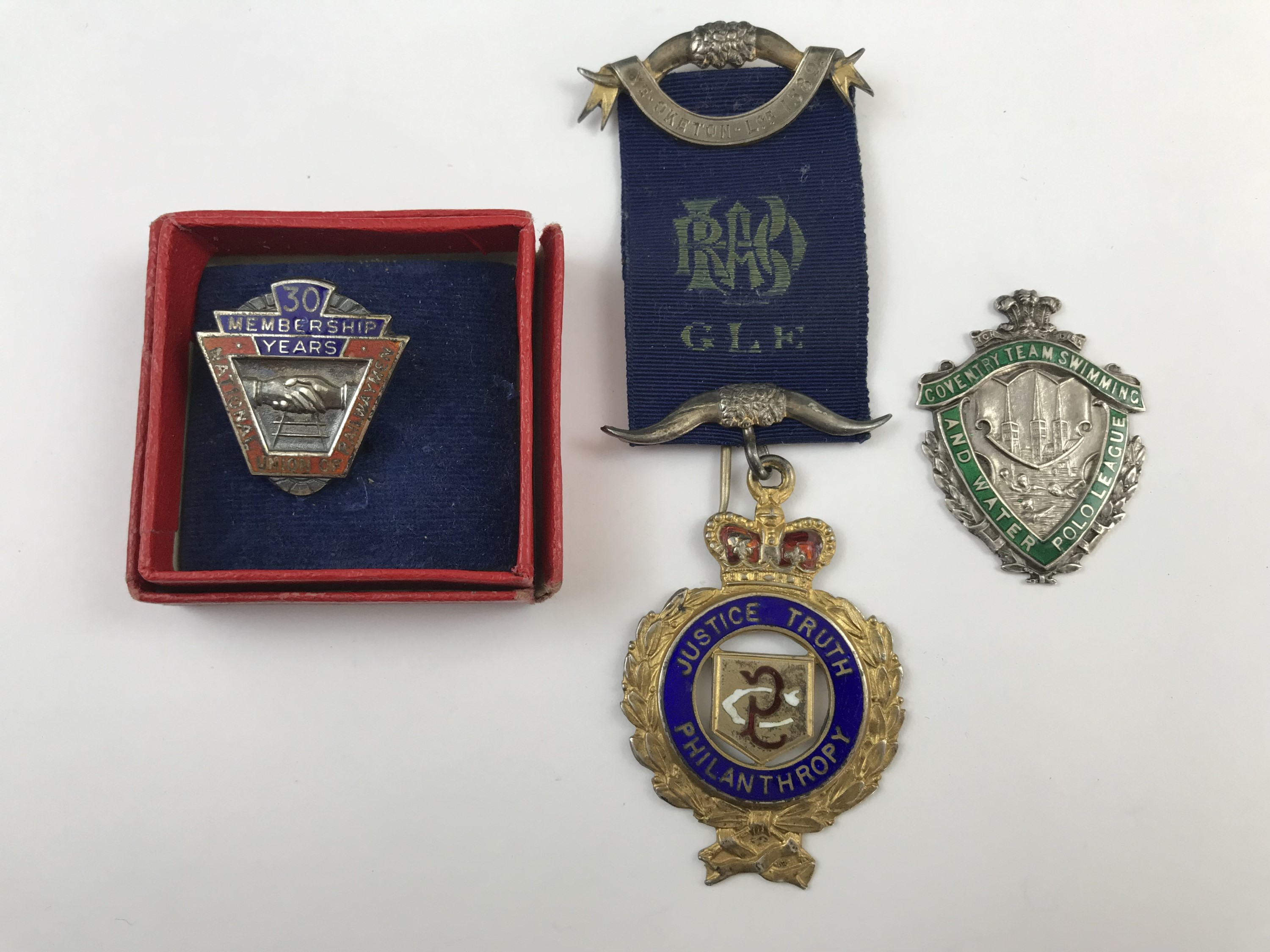 Lot 54 - A George V silver-gilt Masonic medal, Birmingham, 1913, a white-metal Coventry Team Swimming and