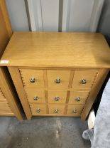 Lot 786 - A set of contemporary oak-effect CD storage drawers, 59 x 32 x 72 cm