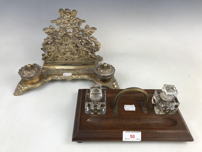 Lot 50 - A Victorian oak desk inkstandish together with a brass desk inkstandish letter rack