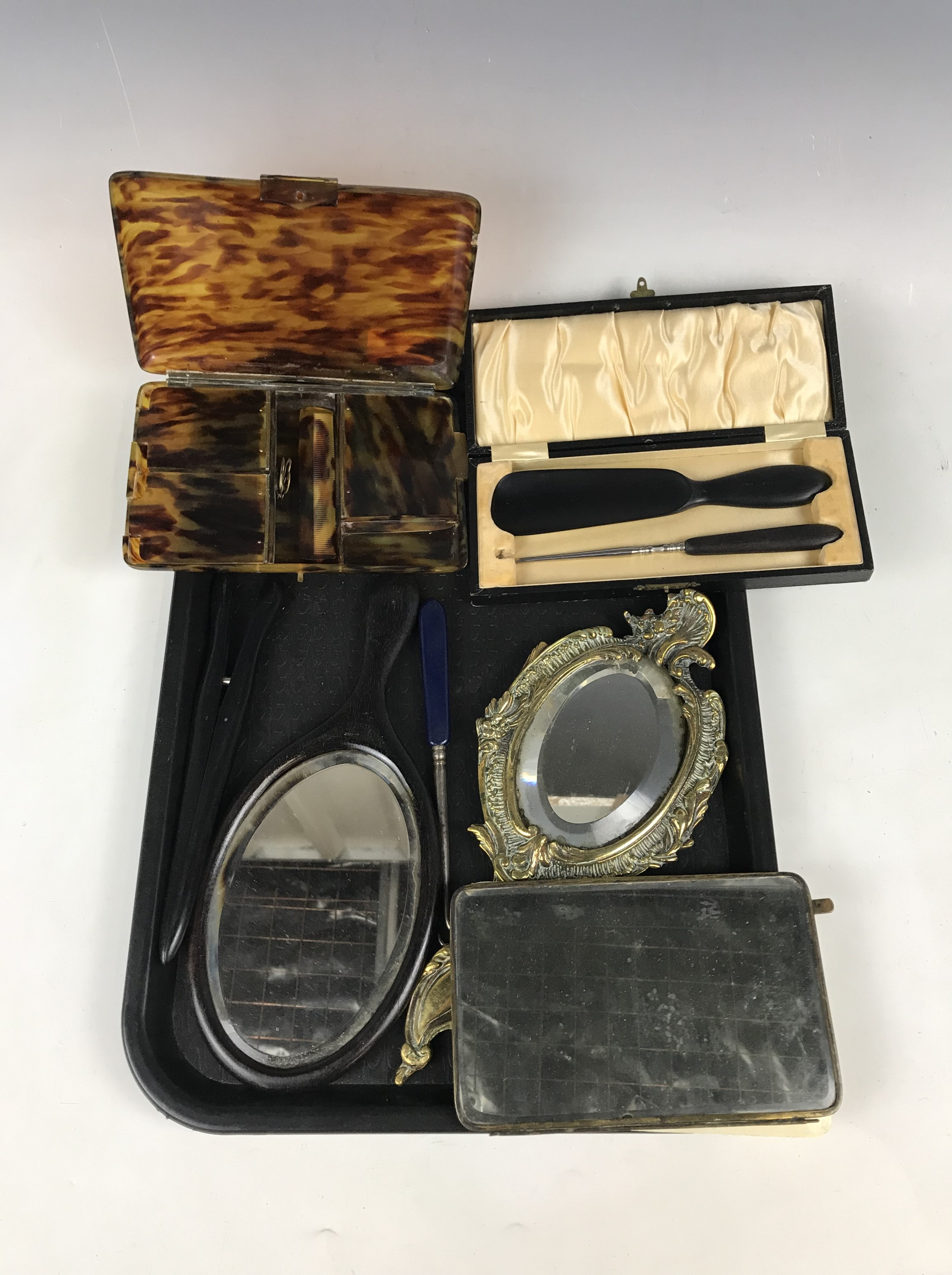Lot 12 - Wood and brass hand mirrors together with ebonised glove stretchers etc