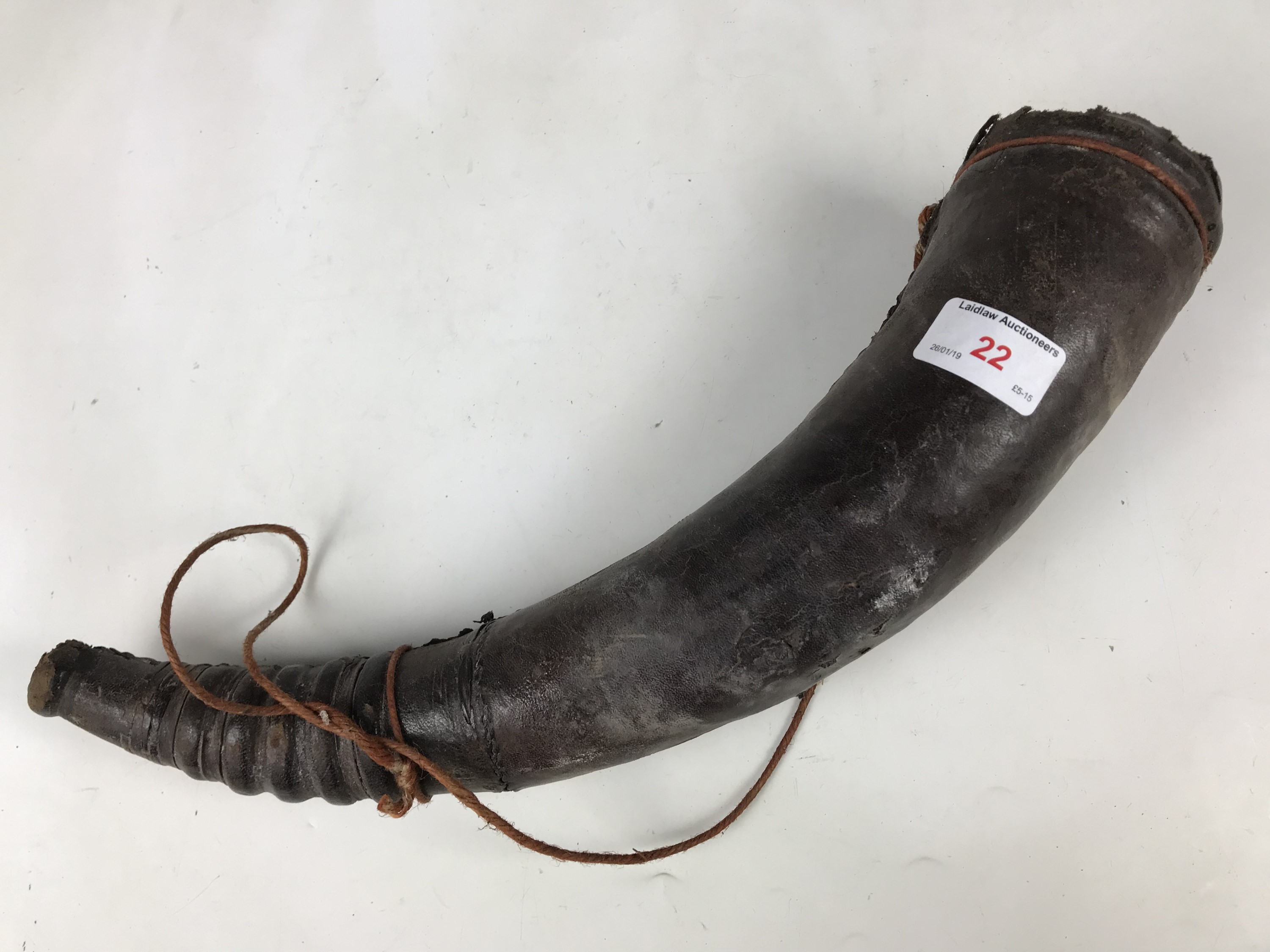 Lot 22 - A leather bound hunting horn