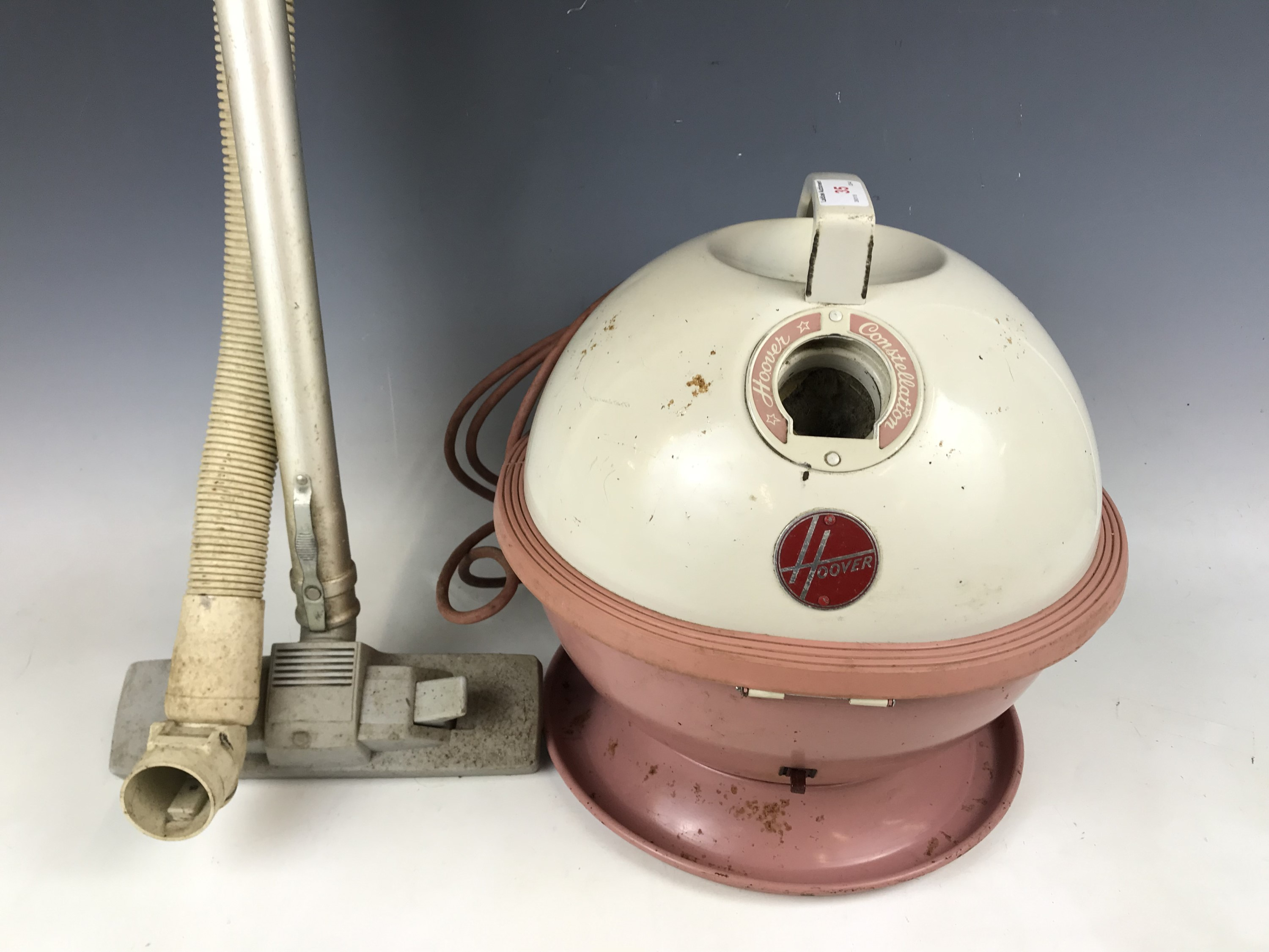 """Lot 35 - A 1950s Hoover """"Constellation"""" vacuum cleaner in pink"""