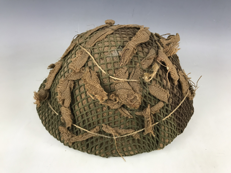 Lot 13 - A British Army Mk 5 steel helmet
