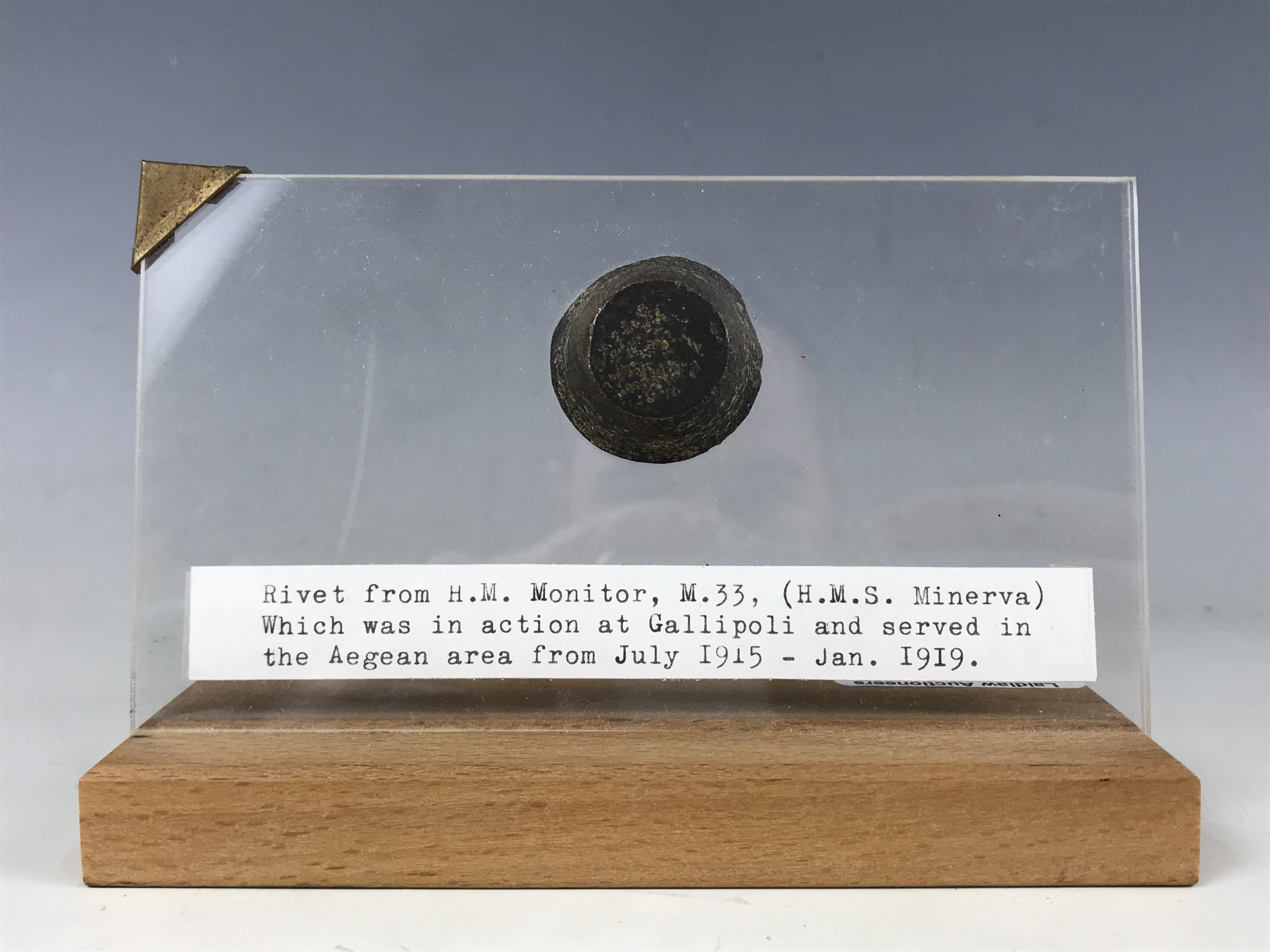 Lot 49 - A mounted rivet bearing label From H M Monitor M33 (HMS Minerva) which was in action at Gallipoli