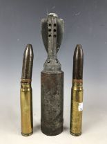 Lot 14 - An inert 1942 2-inch mortar smoke shell, together with two 20 mm canon rounds