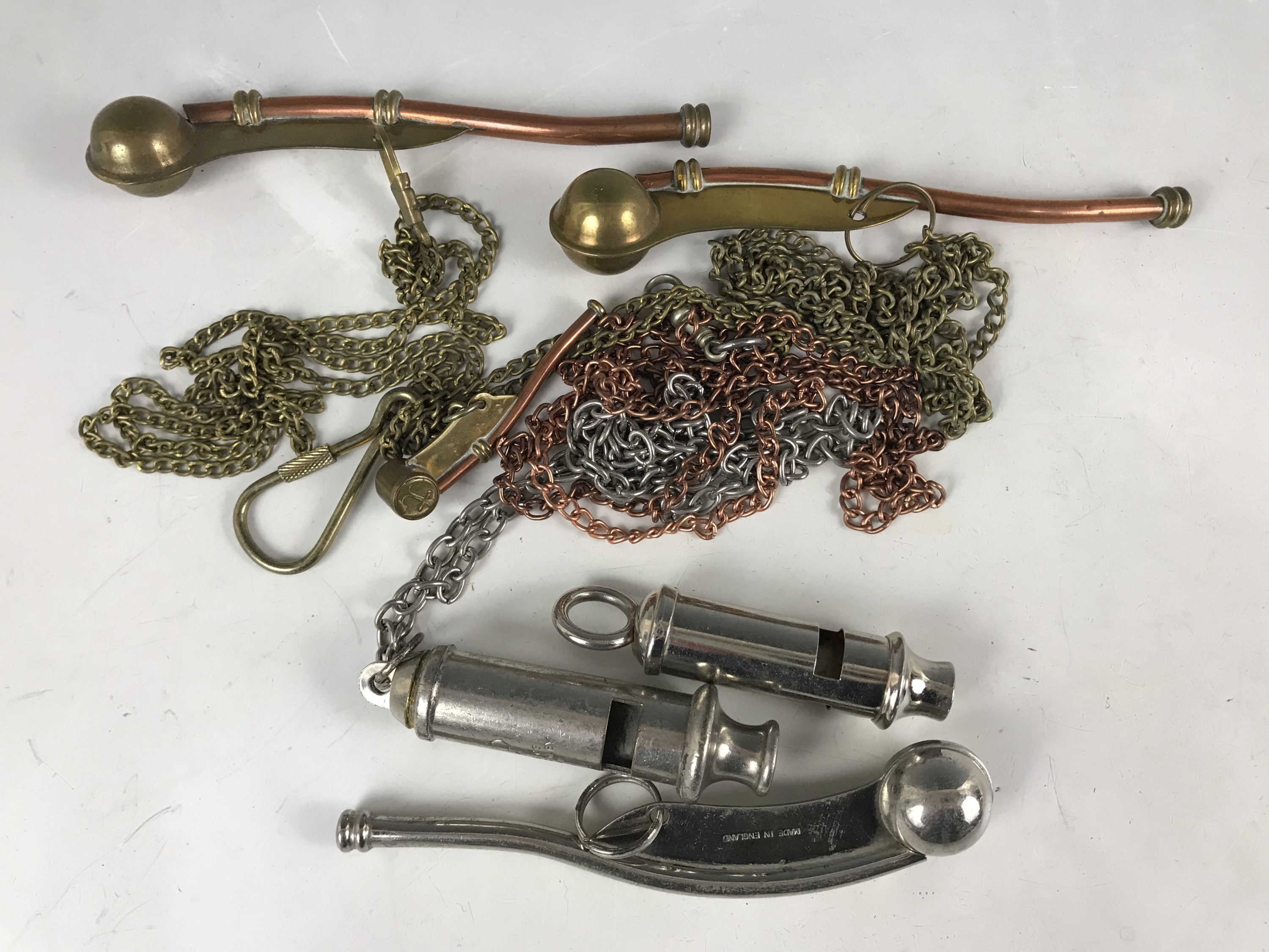 Lot 35 - Several Bosuns' calls, an ARP whistle etc
