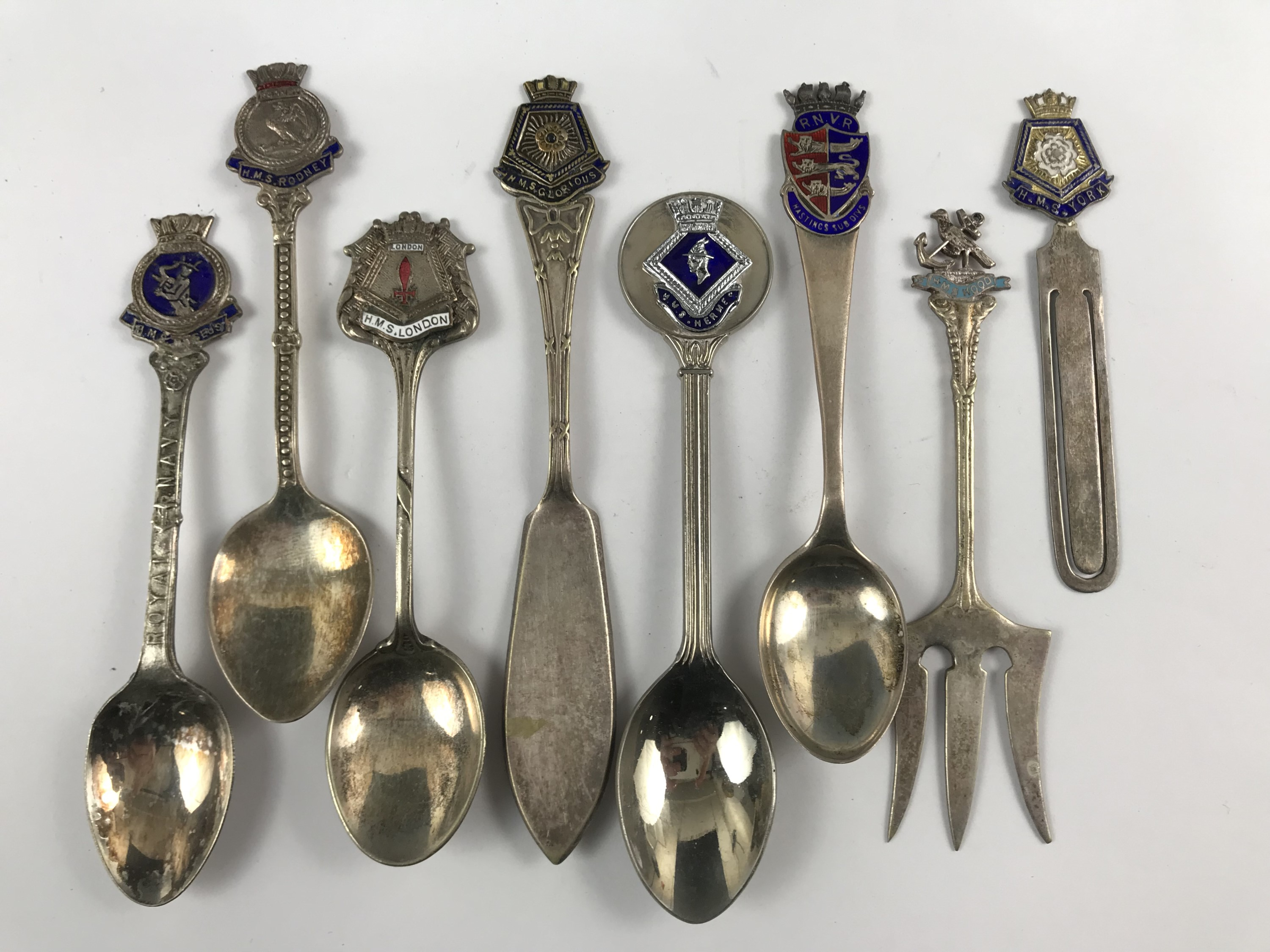 Lot 37 - A number of Royal Navy and similar commemorative spoons and a book mark